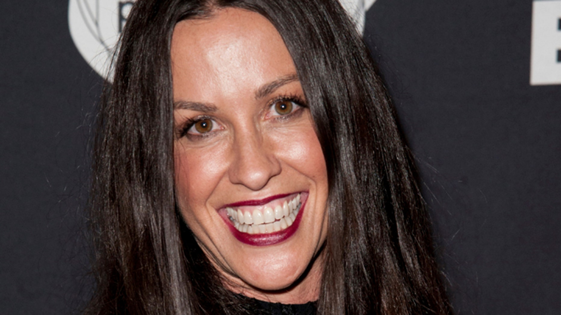 FILE - This June 20, 2014 file photo Alanis Morissette arrives at the 4th Annual Production Of The 24 Hour Plays After-Party in Santa Monica, Calif.