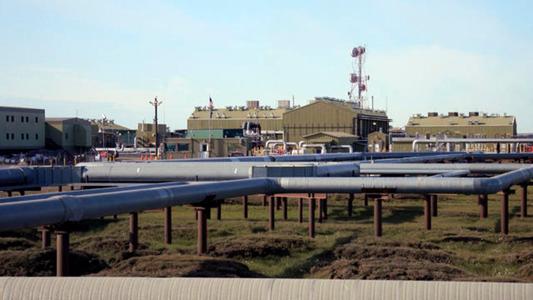 Shown here are oil and gas pipelines running into Alyeska's trans-Alaska oil pipeline pump station in Deadhorse, Alaska.