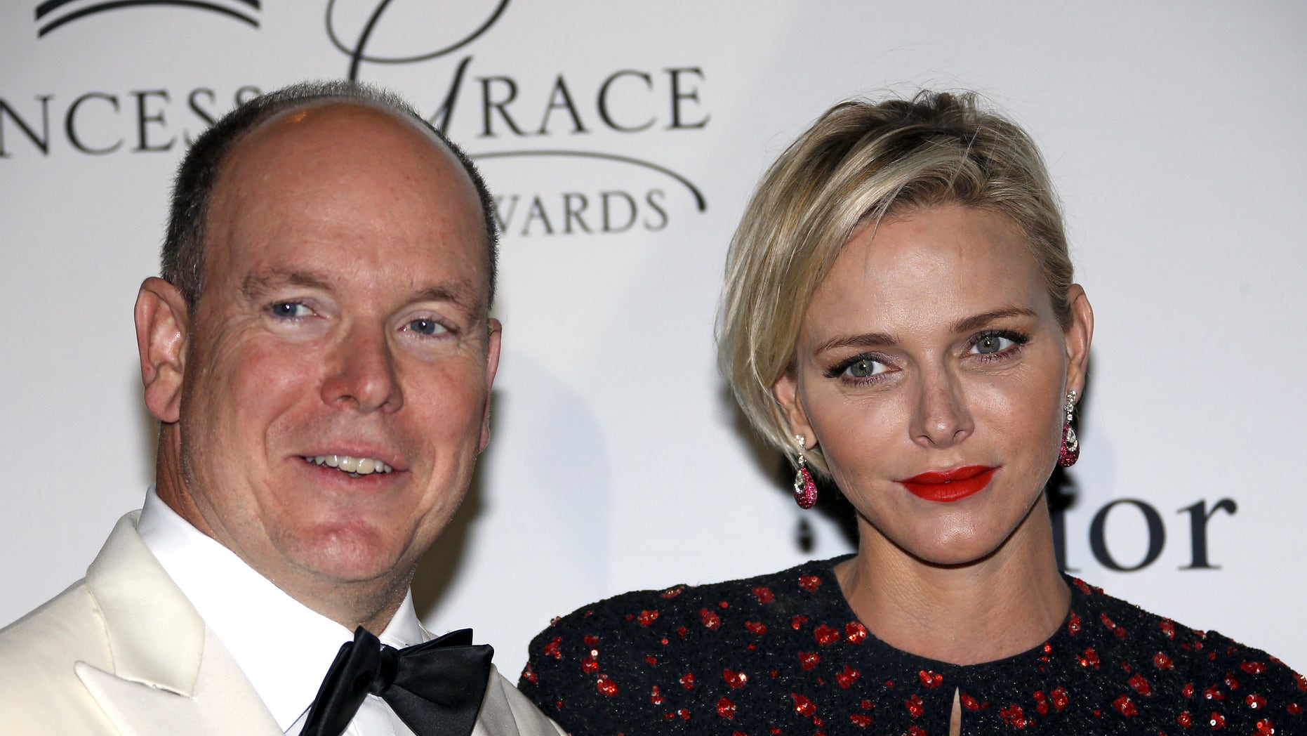 September 5, 2015. Prince Albert II of Monaco and his wife Princess Charlene pose at the Princess Grace Awards gala in Monaco.