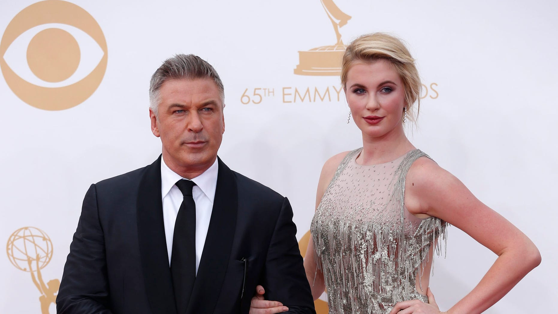 """Actor Alec Baldwin, from the NBC sitcom """"30 Rock,"""" arrives with his daughter Ireland at the 65th Primetime Emmy Awards in Los Angeles September 22, 2013.  REUTERS/Mario Anzuoni (UNITED STATES  - Tags: ENTERTAINMENT)  (EMMYS-ARRIVALS) - RTX13VQY"""