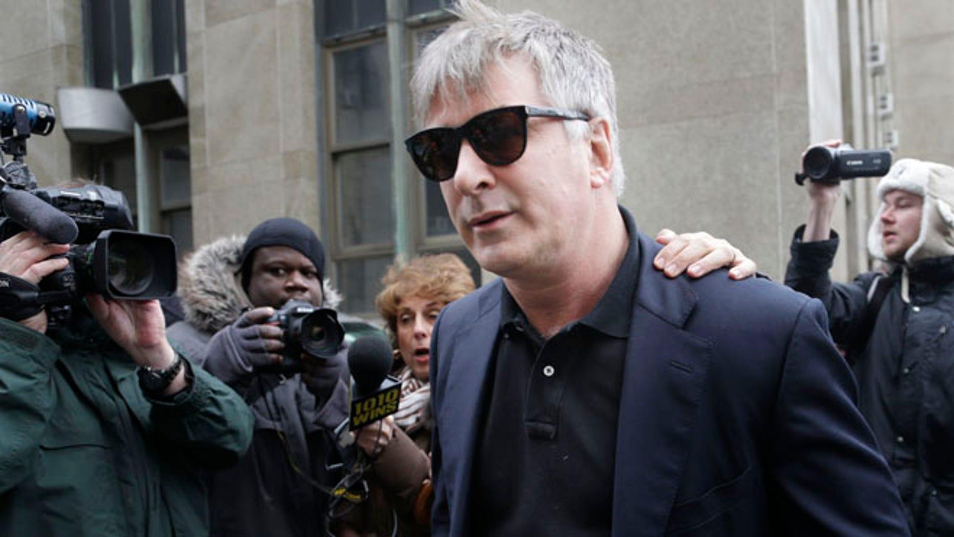 Nov. 12, 2013: Actor Alec Baldwin leaves criminal court in New York.