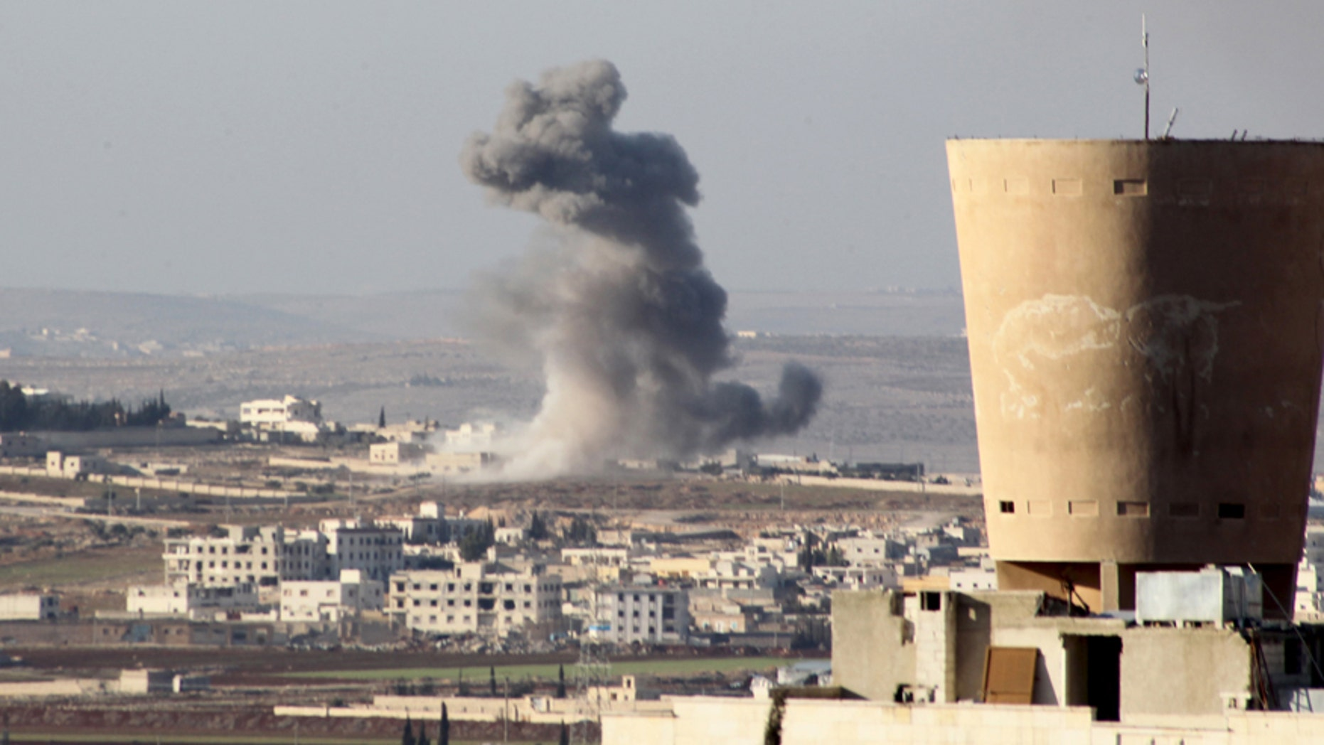 Feb. 3, 2016: Smoke rises after airstrikes by pro-Syrian government forces in Anadan city, about 10 kilometers away from the towns of Nubul and Zahraa, Northern Aleppo countryside, Syria.