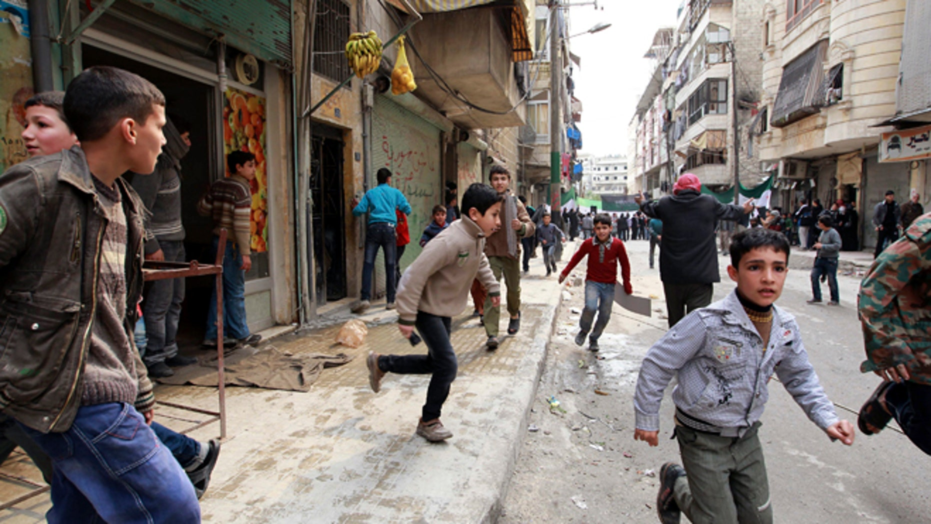 Feb. 22, 2013: People run upon hearing a nearby plane bombing during a protest against Syrian President Bashar al-Assad in the al-Katerji Tariq district in Aleppo.