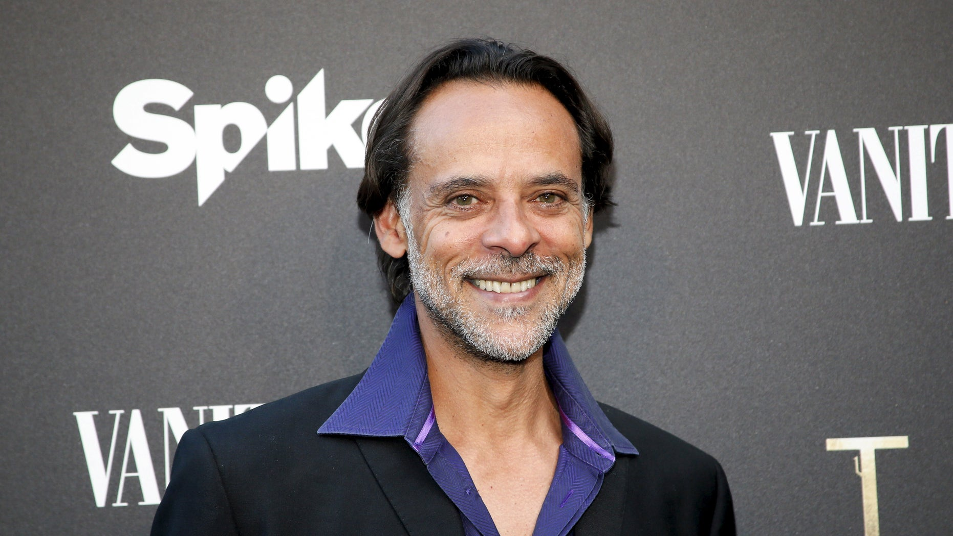 """Cast member Alexander Siddig poses at a cocktail party hosted by Vanity Fair and Spike TV to celebrate Spike's new event series """"Tut,"""" at Chateau Marmont in West Hollywood, California, July 8, 2015. REUTERS/Danny Moloshok - RTX1JN5E"""