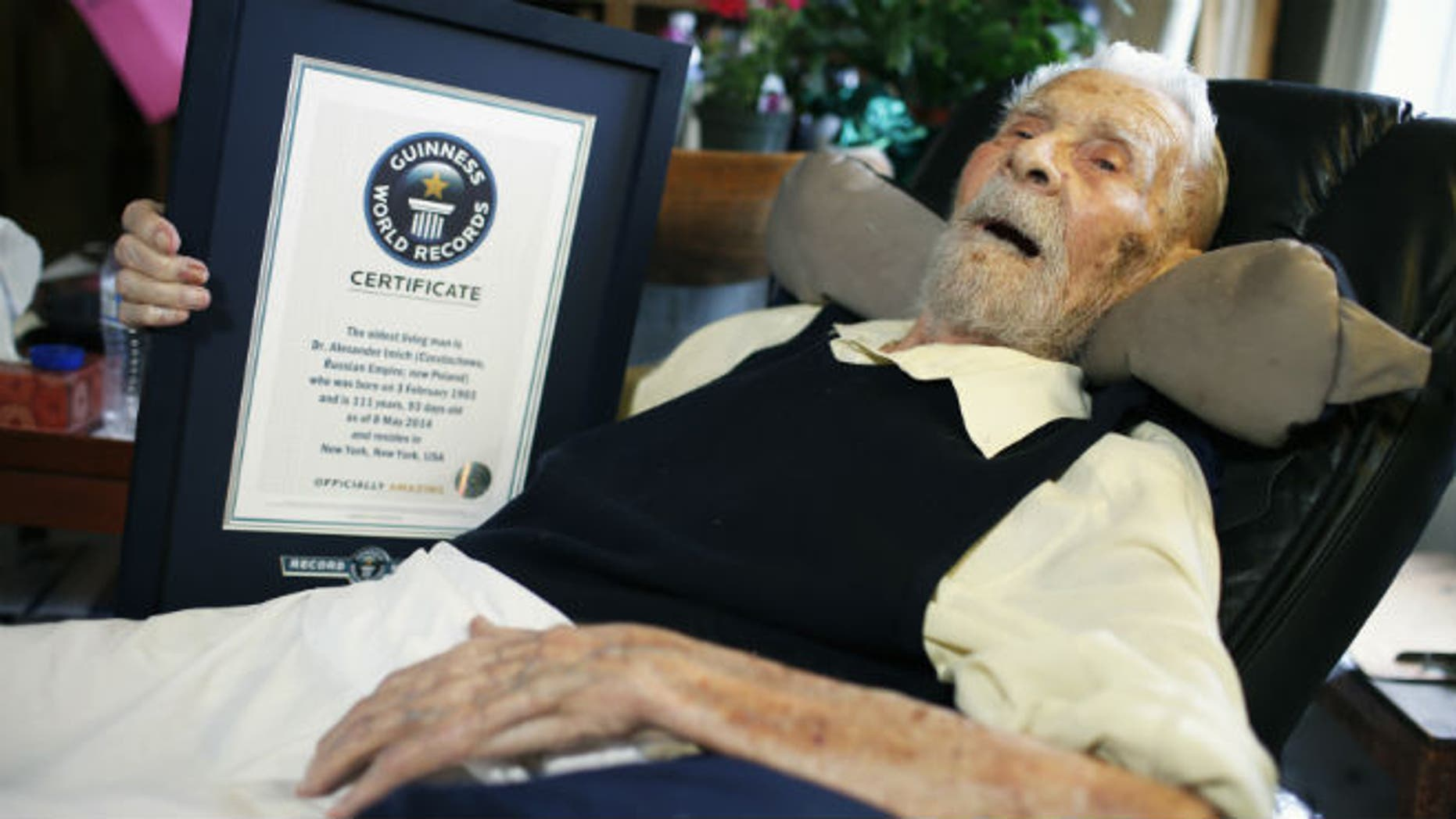 111-year-old Alexander Imich holds a Guinness World Records certificate recognizing him as the world's oldest living man; he passed away on June 8. (REUTERS/Mike Segar)