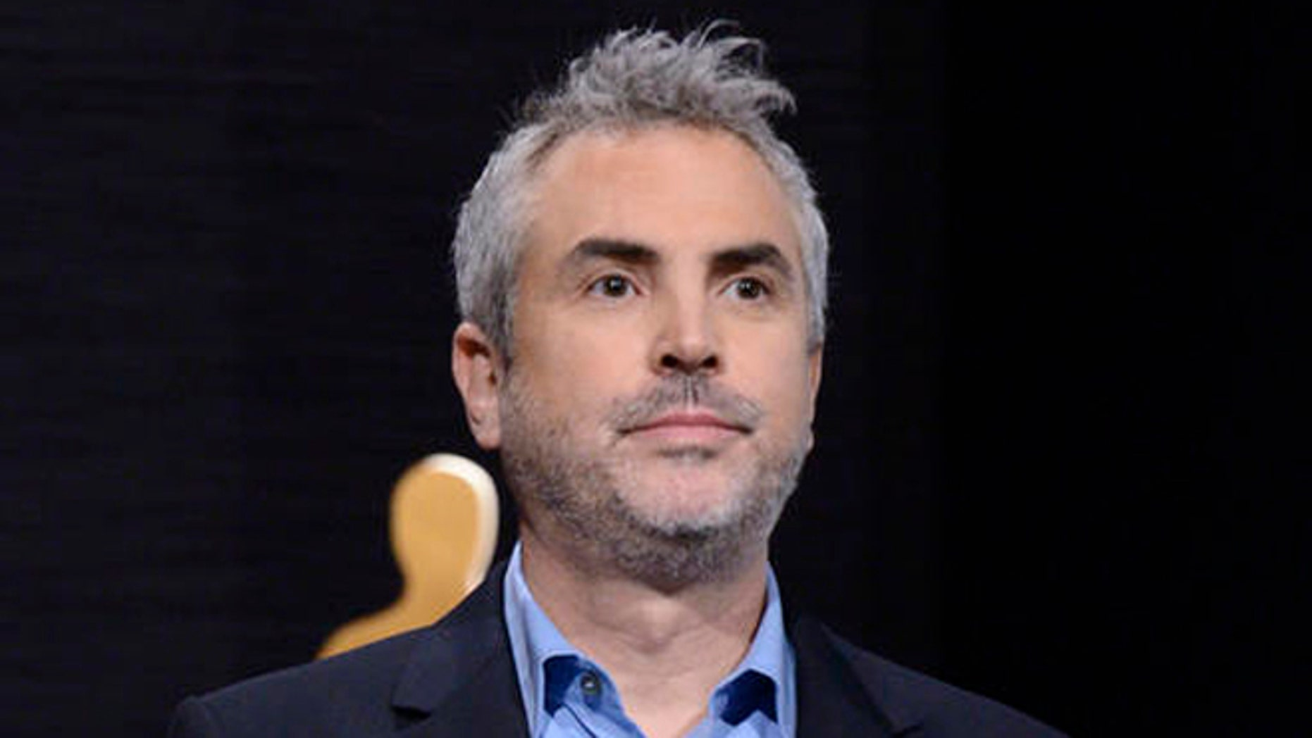 FILE - In this Jan. 15, 2015 file photo, Alfonso Cuaron announces the Academy Awards nominations at the 87th Academy Awards nomination ceremony in Beverly Hills, Calif.  Cuaron's new project will take on a year in the life of a middle class family in Mexico City in the early 1970s.  It will be his first film since Gravity which won seven Oscars in 2014, including Best Director. (Photo by Dan Steinberg/Invision/AP, File)