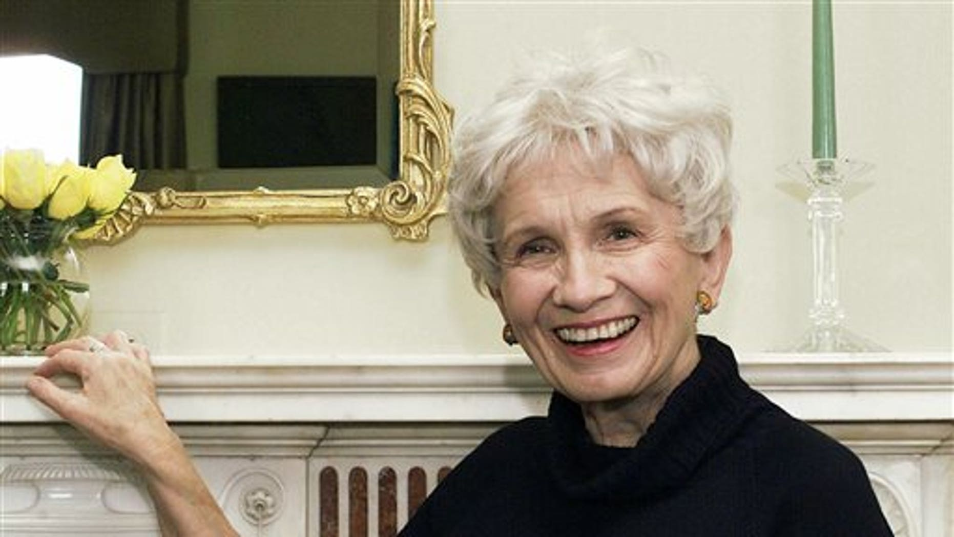 In this Oct. 28, 2002 file photo, Canadian author Alice Munro poses for a photograph at the Canadian Consulate's residence in New York. Munro has won this year's Nobel Prize in literature it was announced Thursday Oct. 10, 2013.