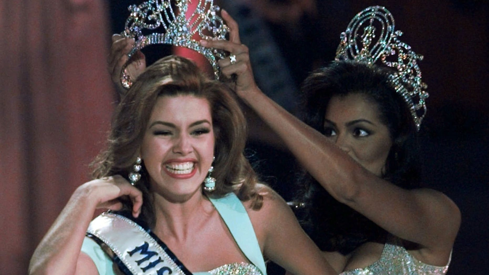 1996 Miss Universe Alicia Machado of Venezuela is crowned by the 1995 winner Chelsi Smith at the Miss Universe competition in Las Vegas.