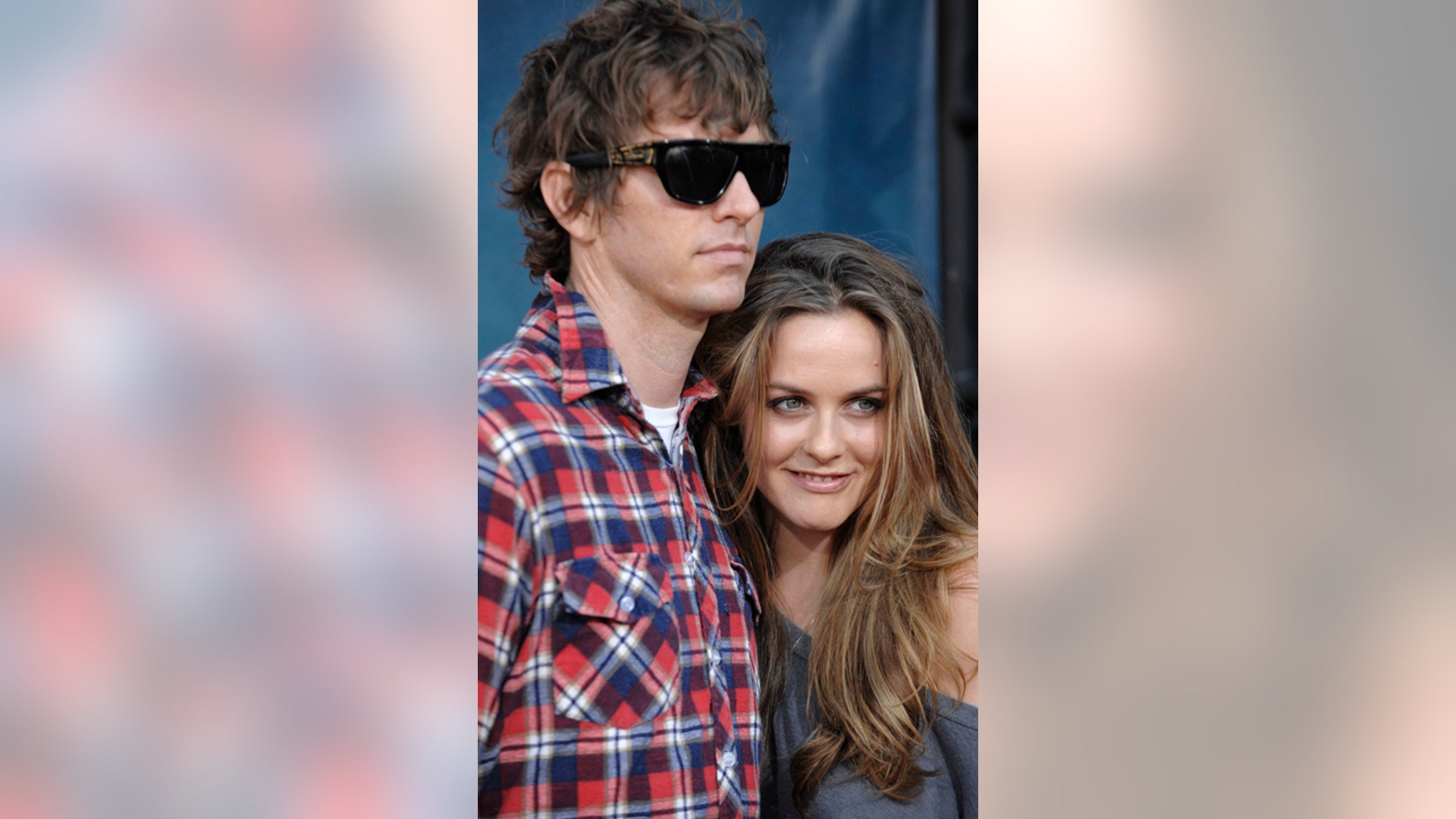"""FILE - In this Thursday July 31, 2008 file photo, Christopher Jarecki and Alicia Silverstone arrive at the premiere of """"Pineapple Express"""" in Mann Village Theater in Los Angeles. Alicia Silverstone is divorcing her husband of nearly 13 years. The """"Clueless"""" actress filed for divorce from Christopher Jarecki on Friday, May 25, 2018 in Los Angeles County Superior Court"""