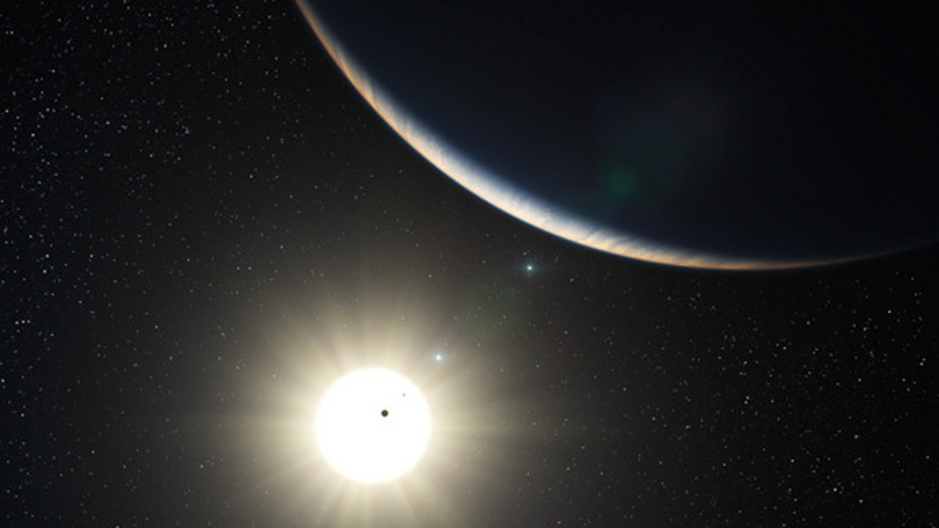 This artist's impression shows the remarkable planetary system around the sun-like star HD 10180.