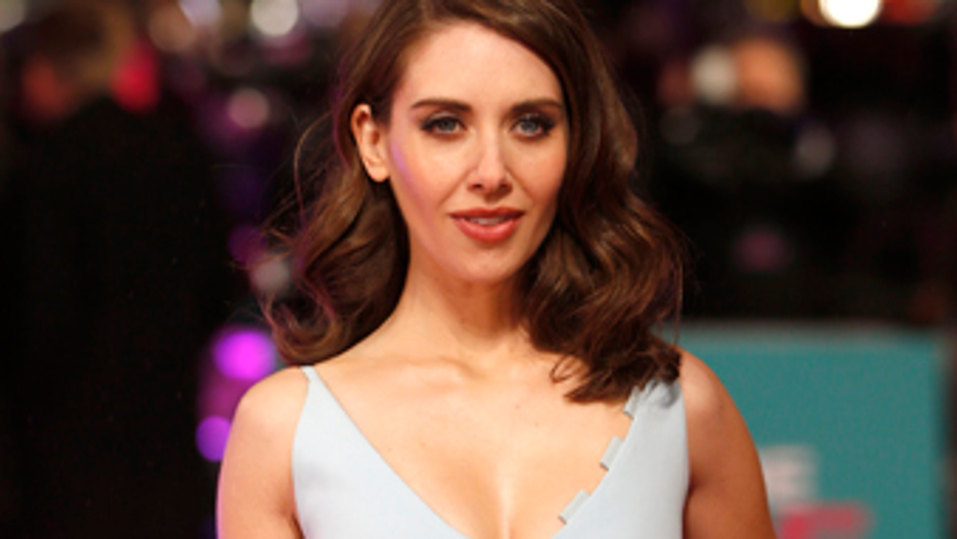 "U.S. actress Alison Brie poses for photographers at the European premiere of the film ""How to be Single"" in London, Britain February 9, 2016."
