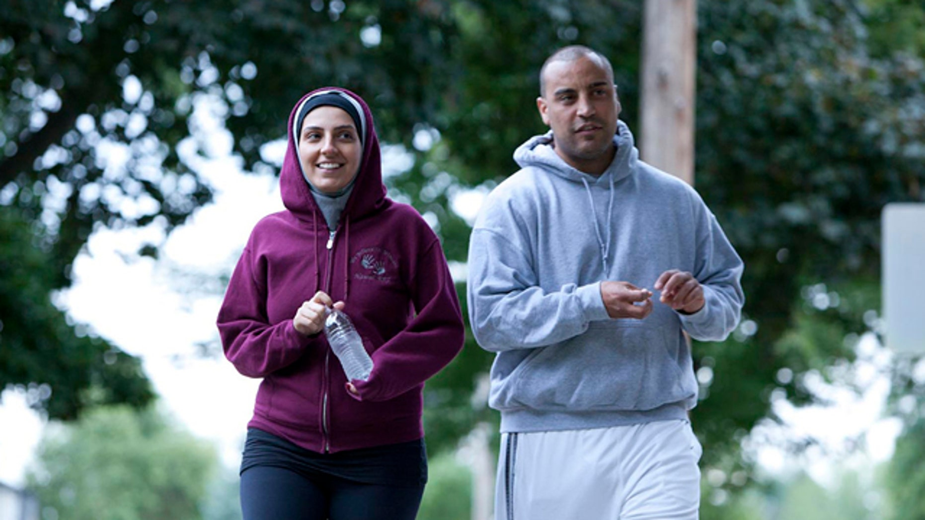"December 11, 2011: Nawal Aoude, a pediatric respiratory therapist, left, and her husband Nader go for a walk in a scene from the TLC series, ""All-American Muslim."""