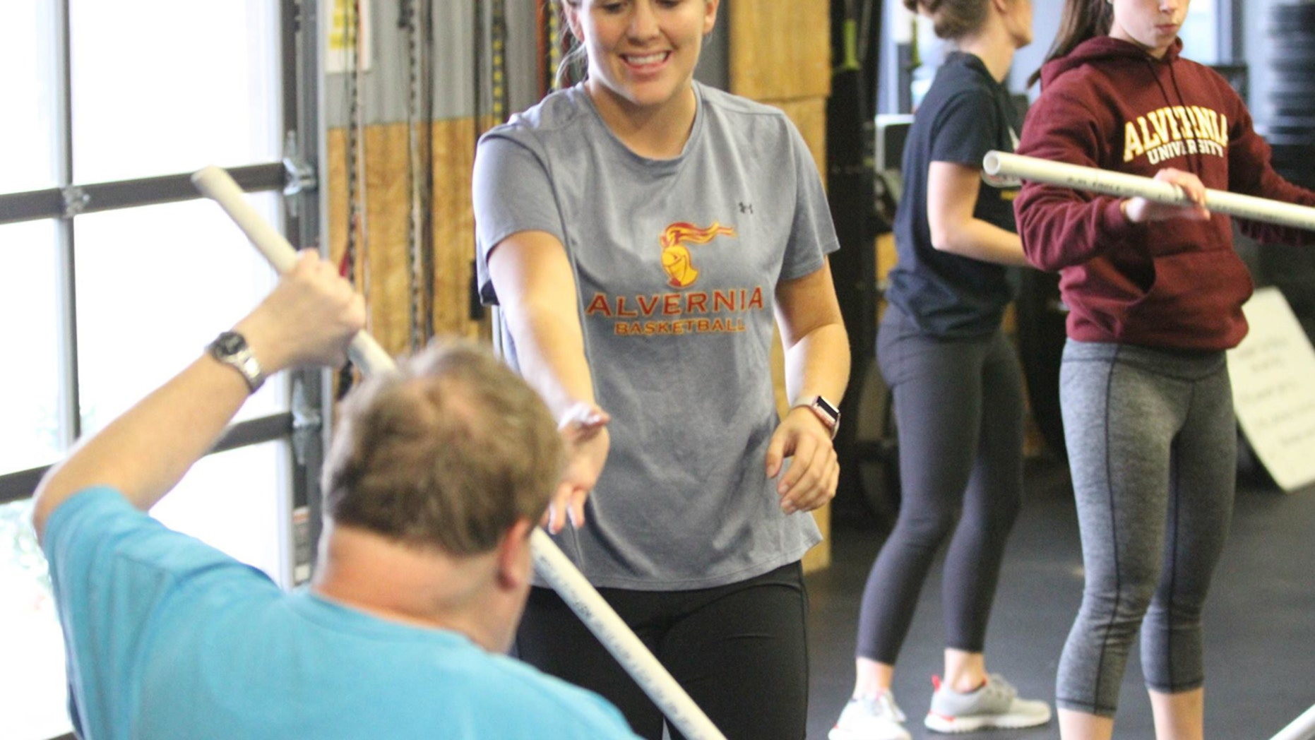 A participant works out with the help of an occupational therapist during an ALL Abilities Fitness class.