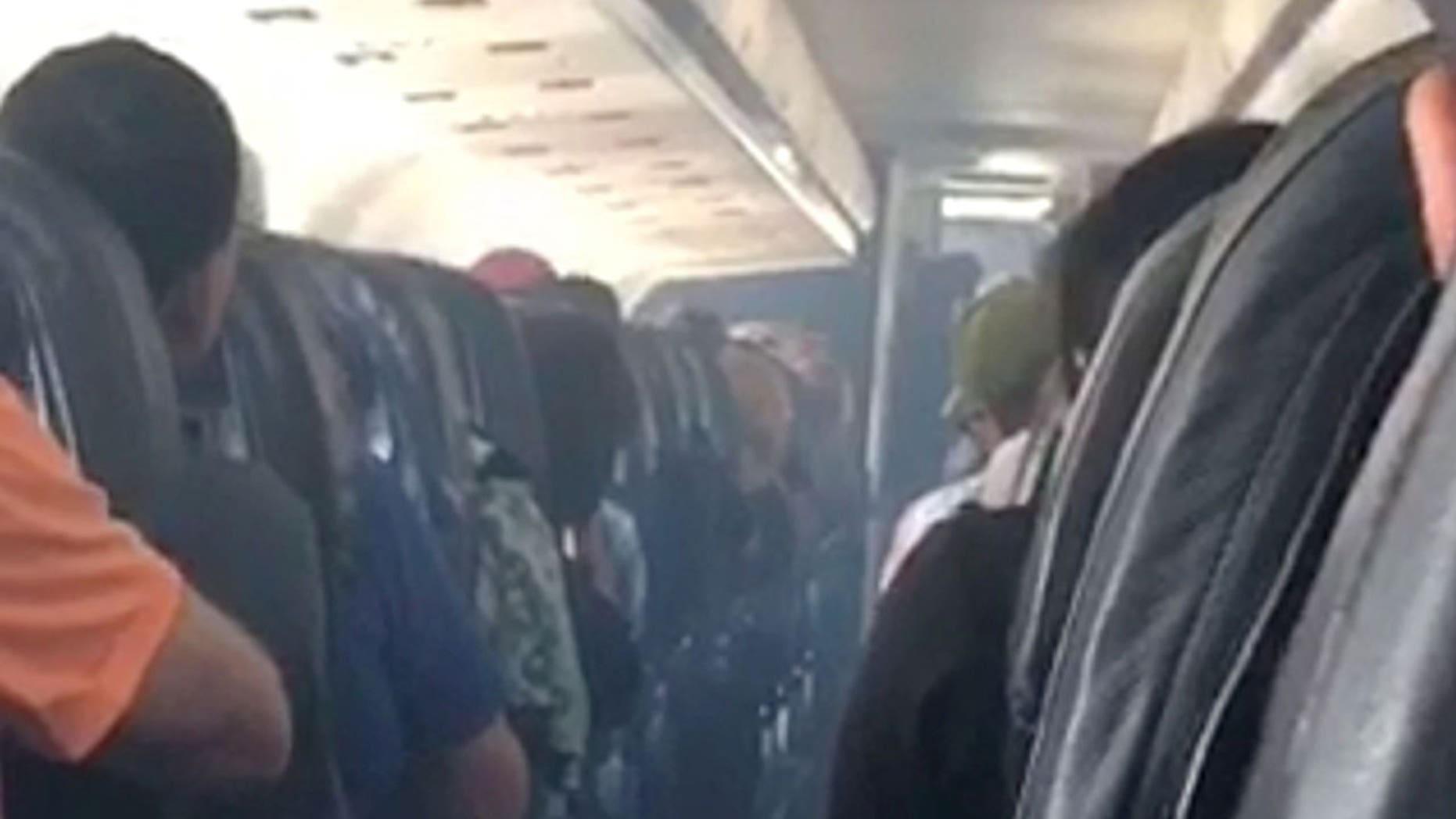 """Allegiant Air says a mechanical issue caused the aircraft cabin to fill with a """"visible haze"""" of smoke."""