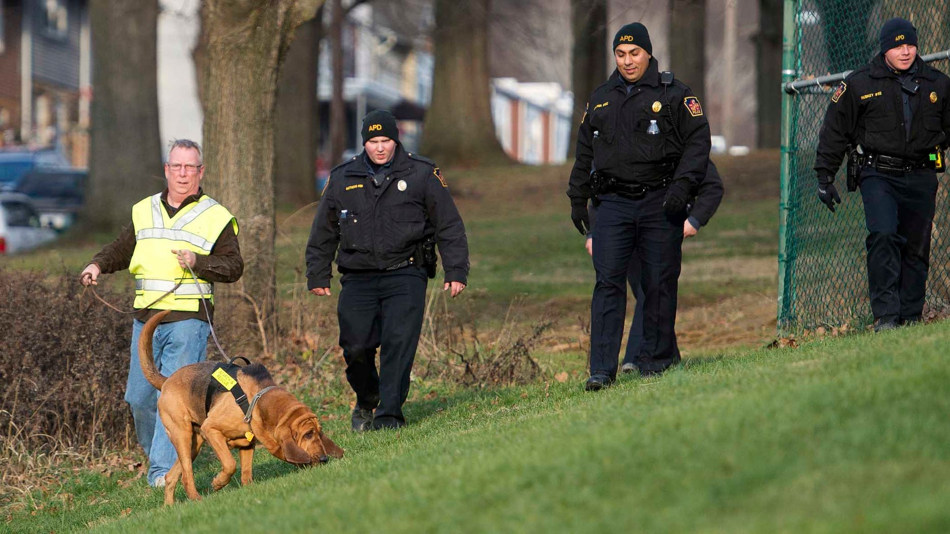 In this Friday, Jan. 1, 2016, photo, Allentown, Pa., police use a search and rescue dog in Keck Park as the search continues for Jayliel Vega Batista, a missing 5-year-old autistic boy who wandered off from a New Year's Eve party on Thursday night. (Chris Shipley/The Morning Call via AP) THE EXPRESS-TIMES OUT; WFMZ OUT; MANDATORY CREDIT