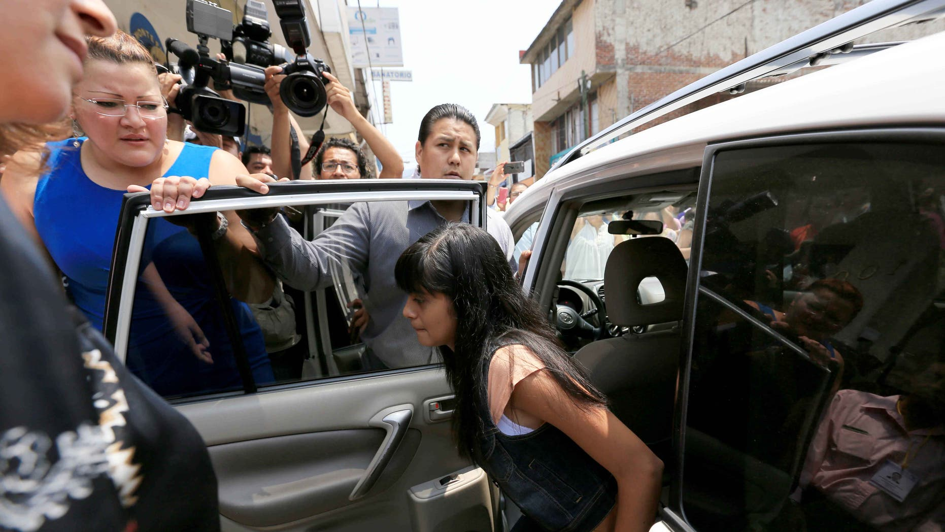 Alondra Diaz Garcia arrives for a court hearing in Los Reyes, Mexico, Tuesday, May 12, 2015.
