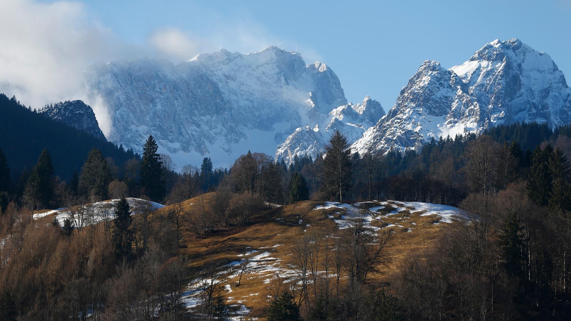 Germany's highest mountain, 9,718 feet Zugspitze (L) is pictured from the Bavarian ski resort of Garmisch-Partenkirchen, Germany, Jan. 29, 2016. (REUTERS/Dominic Ebenbichler)