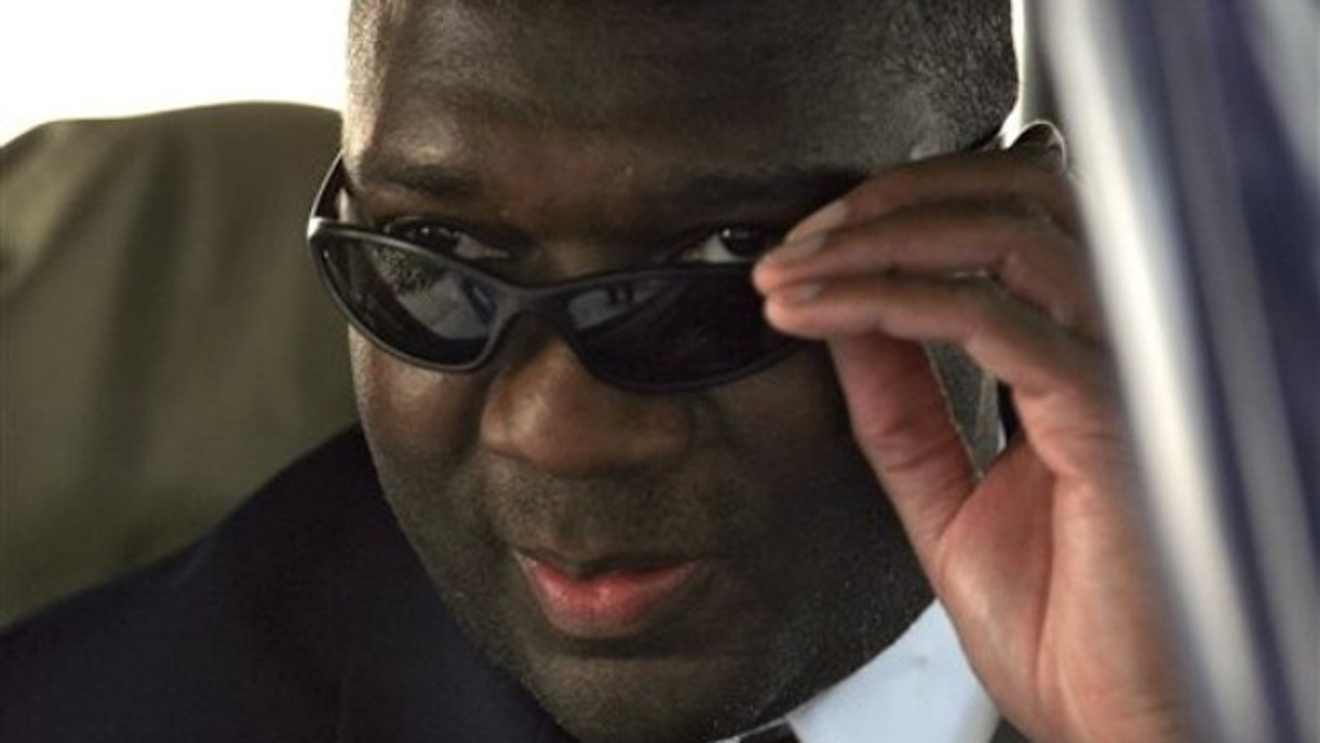 Democratic candidate for U.S. Senate, Alvin Greene, leaves the Richland County Courthouse in Columbia, S.C. , following a bond hearing on his misdemeanor obscenity charge, Thursday, Oct. 7, 2010. (AP)