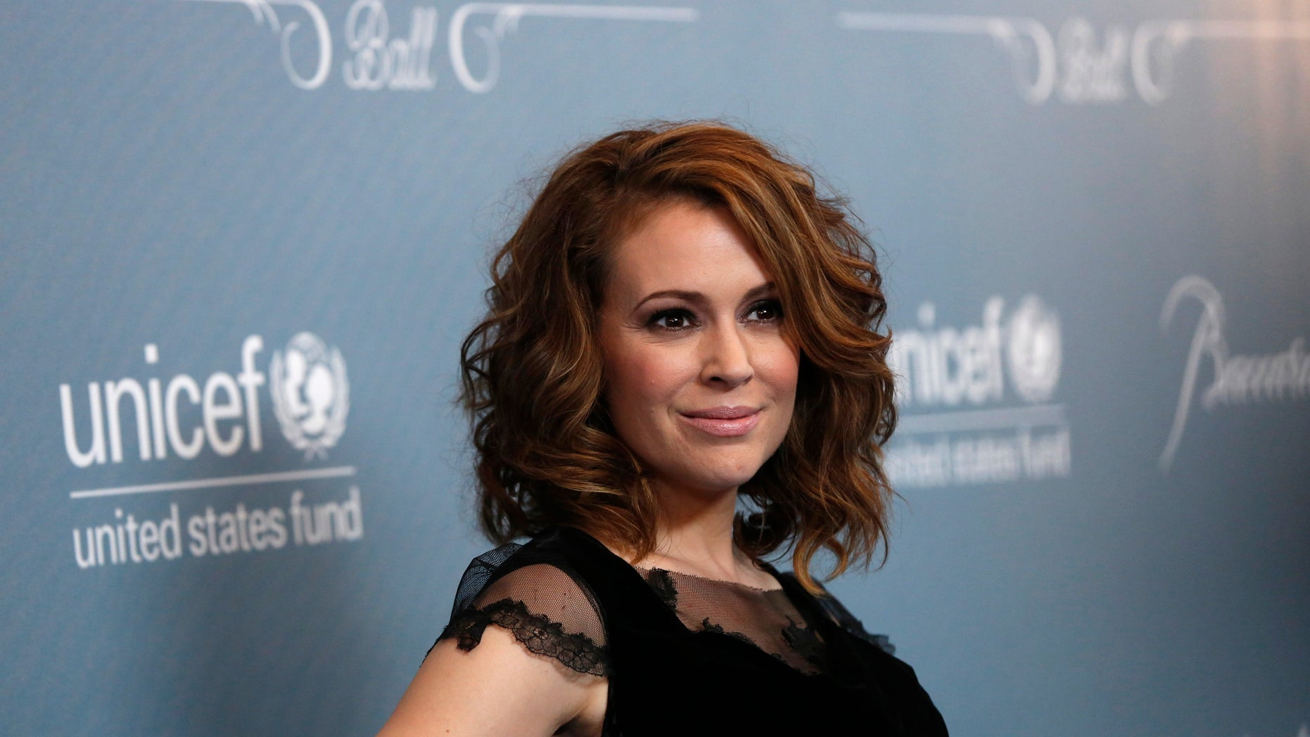 January, 2014. Alyssa Milano poses at a UNICEF fundraising gala in Beverly Hills.