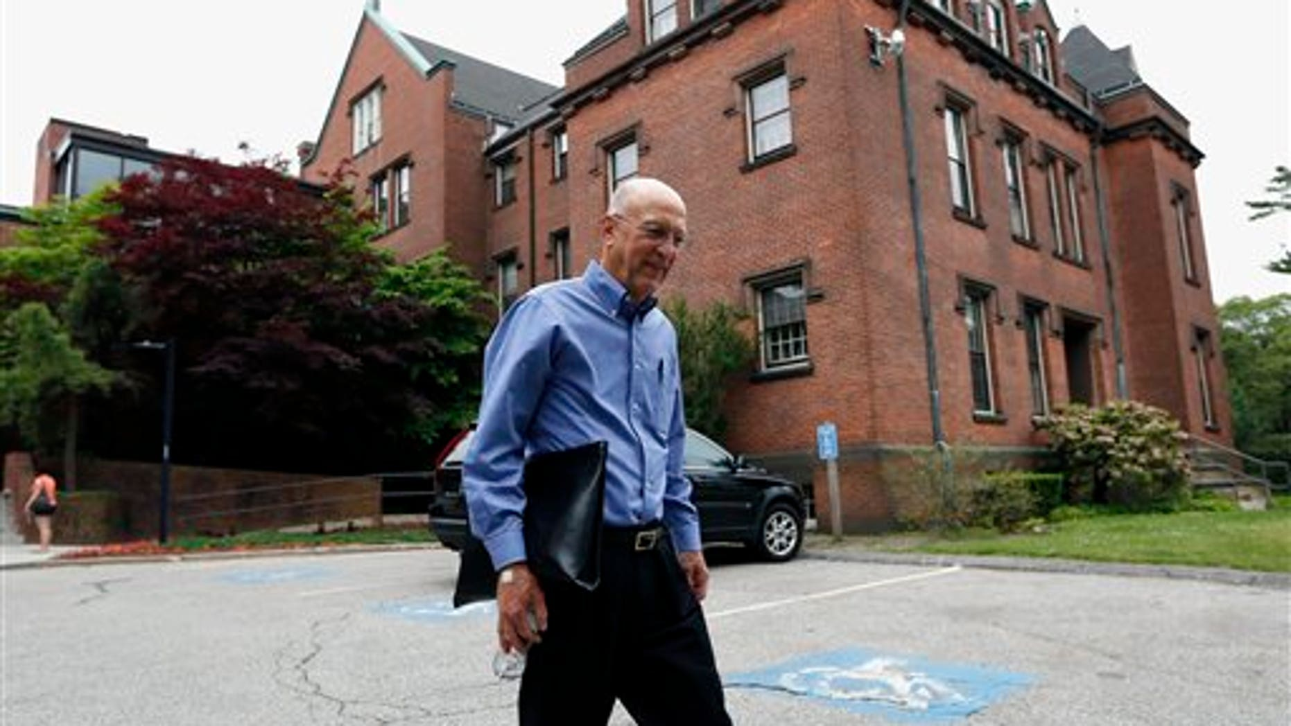 Peter Bristol of Wakefield, R.I. leaves Butler Hospital in Providence, R.I., after receiving an intravenous infusion, Monday, June 9, 2014. Bristol is part of a major study that got under way Monday to see if an experimental drug could protect outwardly healthy seniors whose brains harbor silent signs that they're at risk for Alzheimer's disease. In one of the most ambitious attempts yet to thwart Alzheimer's disease, a major study got under way Monday to see if an experimental drug can protect healthy seniors whose brains harbor silent signs that they're at risk. (AP Photo/Michael Dwyer)