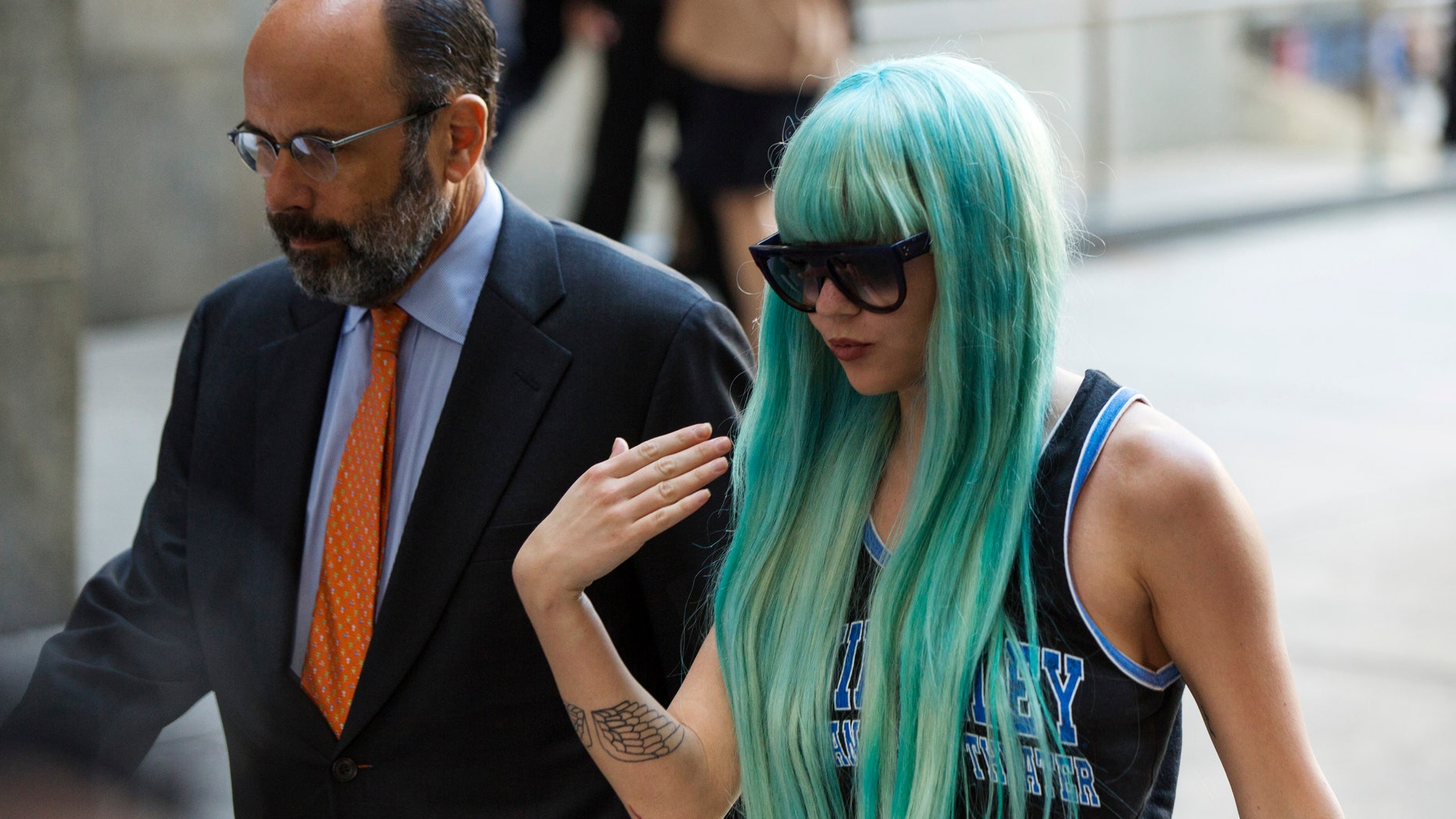 July 9, 2013. Actress Amanda Bynes arrives for a court hearing at Manhattan Criminal Court in New York. Bynes is charged with reckless endangerment and attempted tampering with physical evidence.