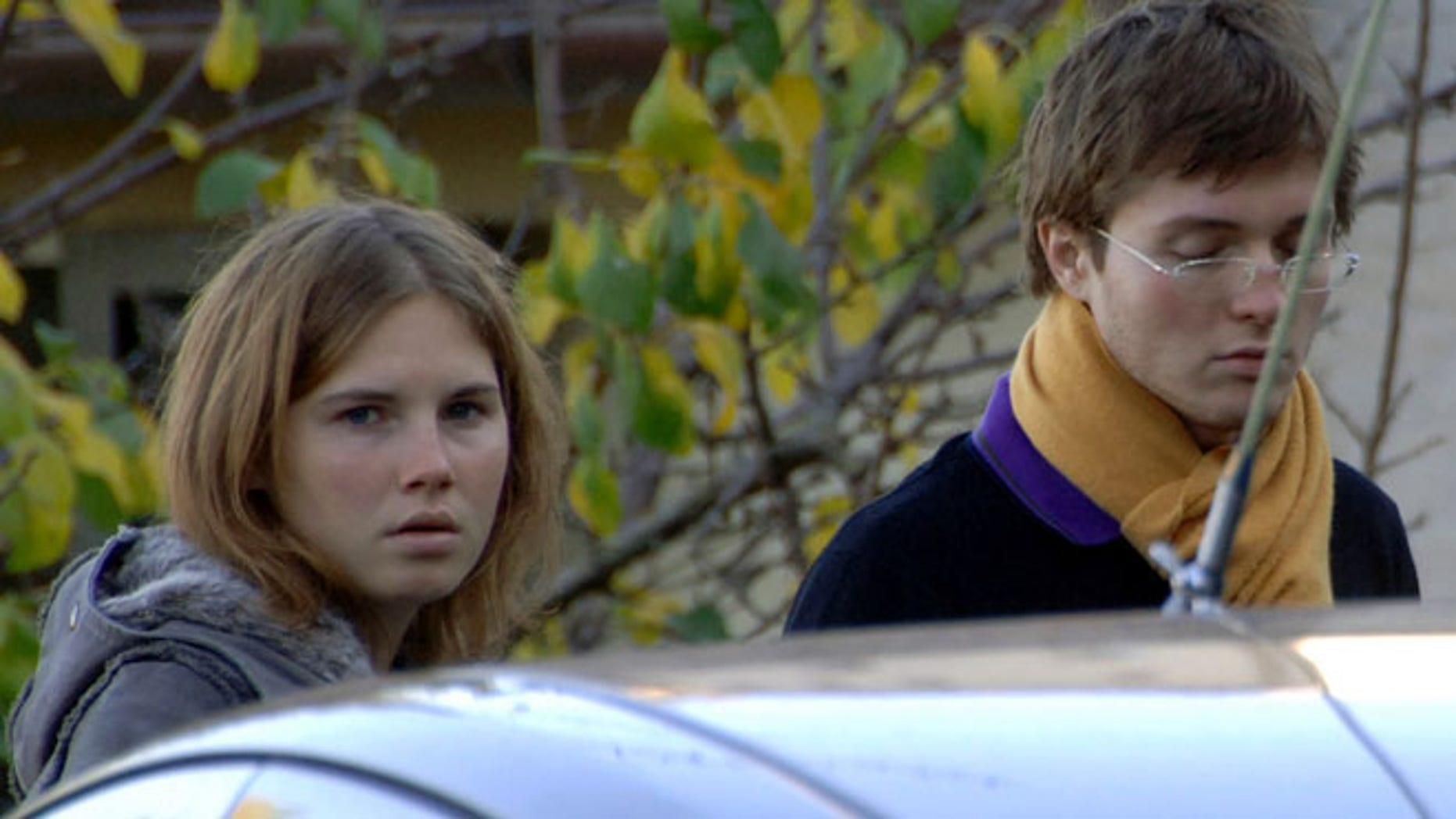 In this Friday Nov. 2, 2007 file photo Amanda Marie Knox, left, and Raffaele Sollecito, stand outside the rented house where 21-year-old British student Meredith Kercher was found dead Friday, in Perugia, Italy. The state's prosecutor is arguing his case that an appeals court should reinstate the guilty verdict against U.S. exchange student Amanda Knox for the grisly 2007 murder of her roommate.