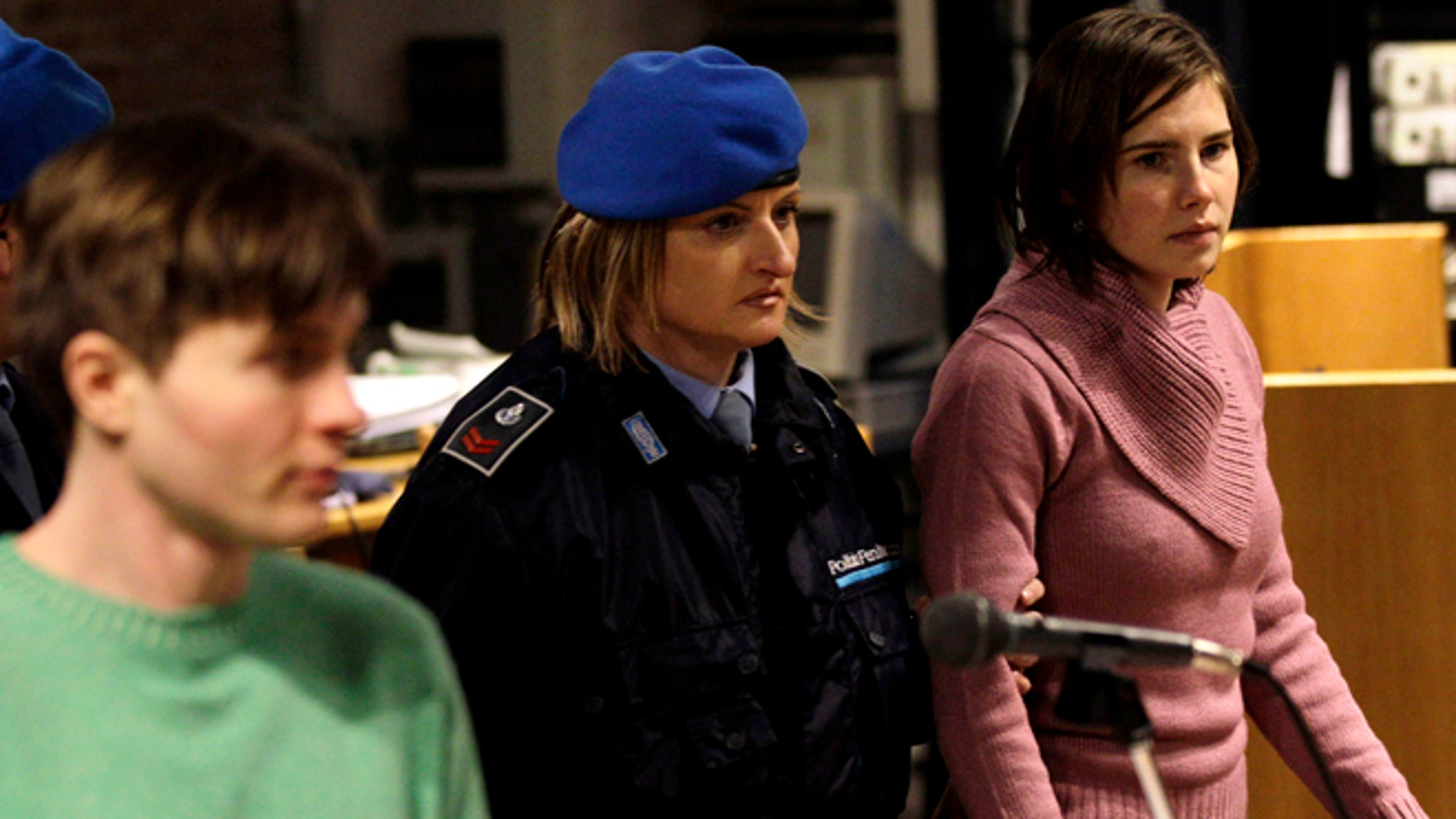 Dec. 18, 2010: In this file photo, U.S. student Amanda Knox, right, walks past Raffaele Sollecito, as she arrives after a break to attend a hearing in her appeals trial at Perugia's courthouse in Italy. Italy's highest criminal court has overturned the acquittal of Amanda Knox and of her former Italian boyfriend, Raffaele Sollecito, in the slaying of her British roommate and ordered a new trial.