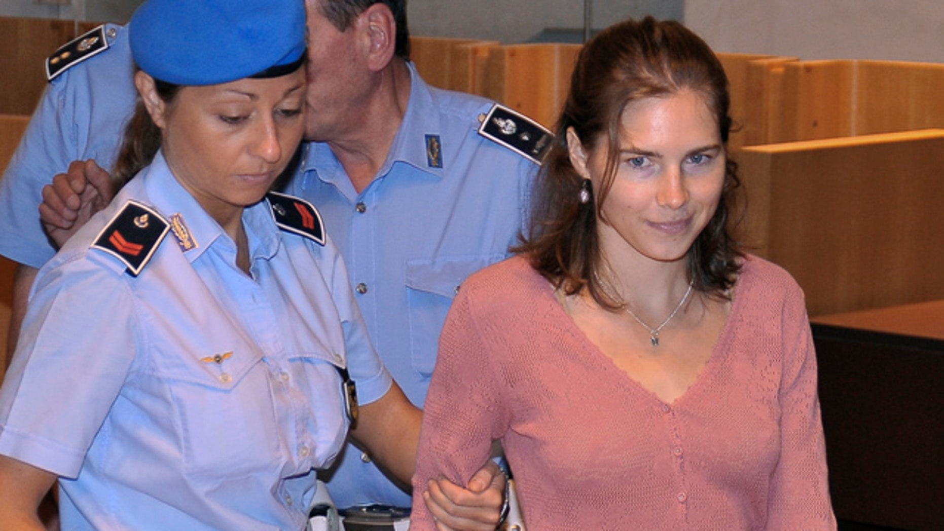 July 30: American student Amanda Knox arrives for a hearing of her appeals murder trial, in Perugia, Italy.