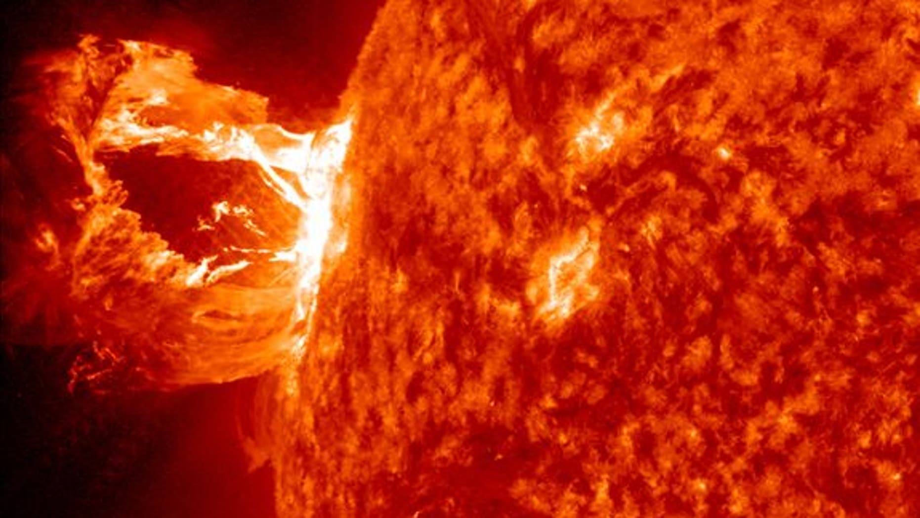 April 16, 2012: A beautiful solar prominence erupts off the east limb (left side) of the sun. This view of the flare was recorded by NASA's Solar Dynamics Observatory.
