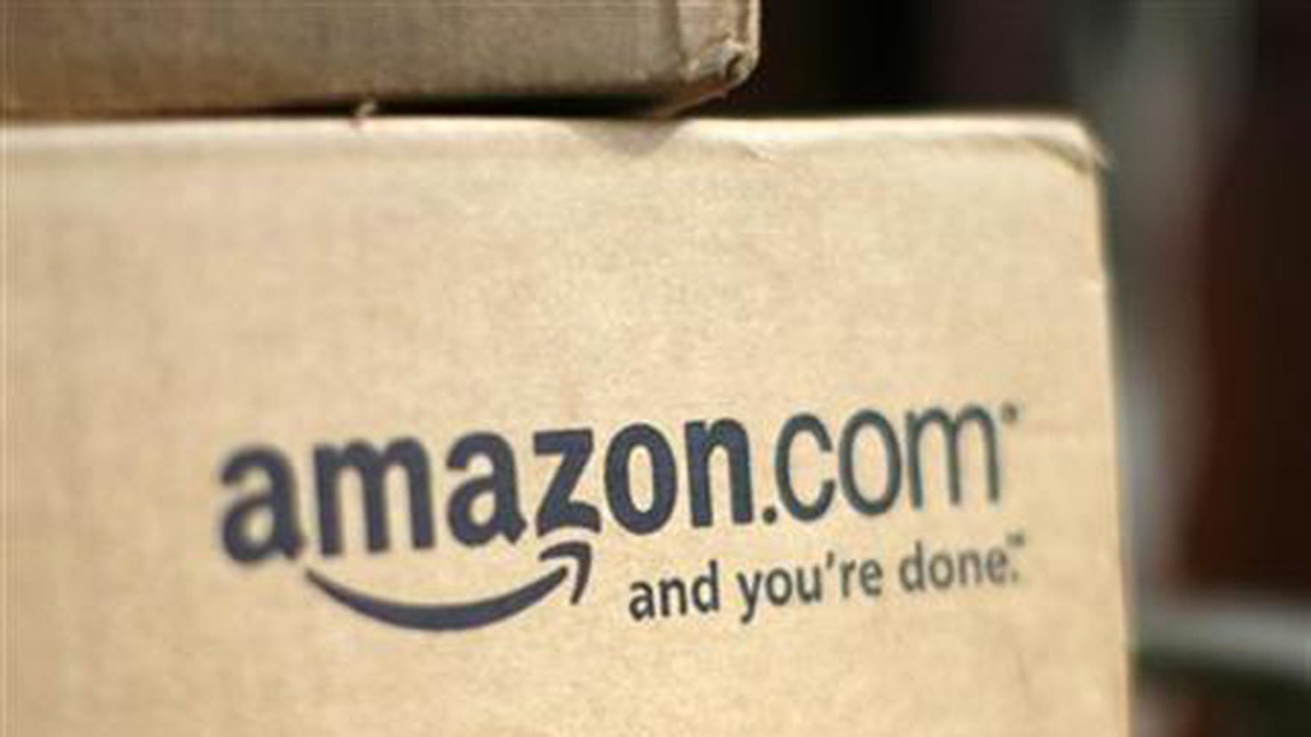 July 23, 2008: A box from Amazon.com sits on the porch of a house in Golden, Colorado.
