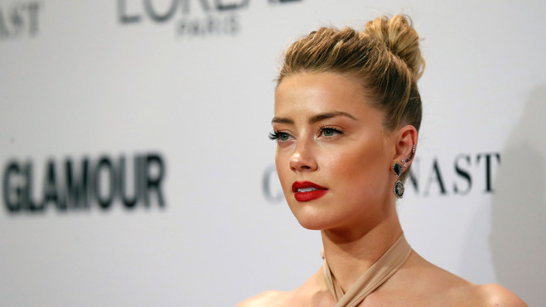 Actor Amber Heard poses at the Glamour Women of the Year Awards in Los Angeles, California, U.S., November 14, 2016. REUTERS/Mario Anzuoni - RTX2TP4P