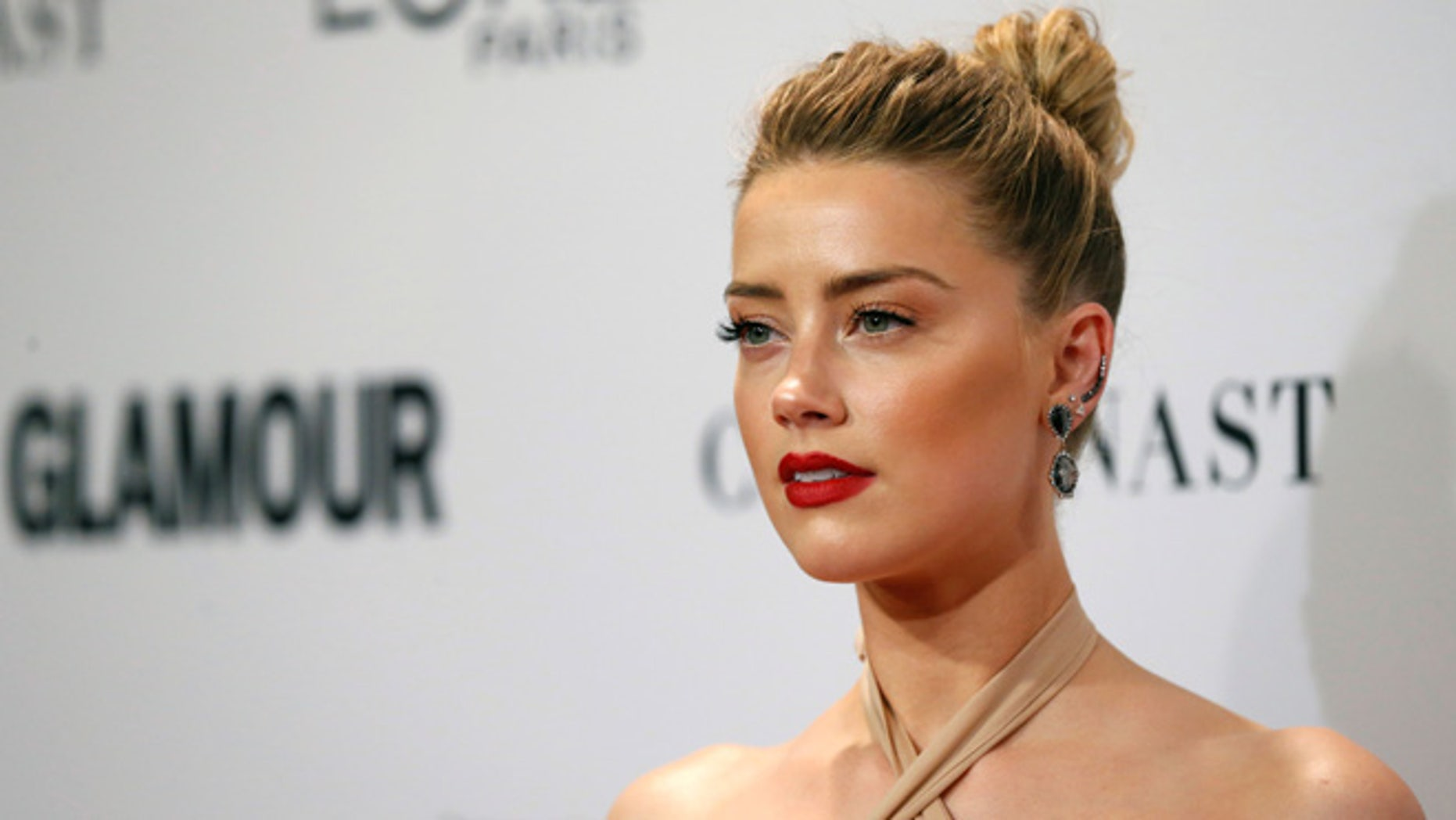 Amber Heard talked about her sexuality at a summit.