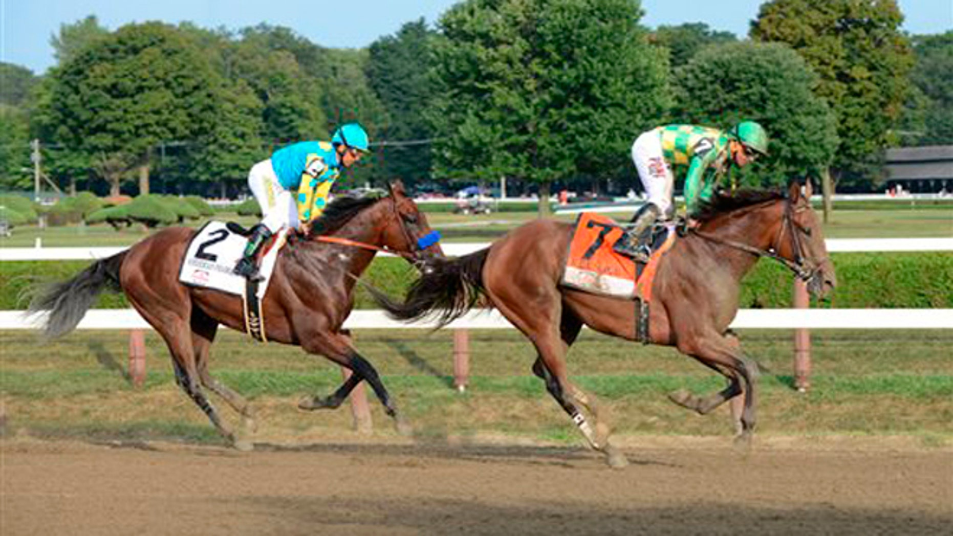 Aug. 29, 2015: Keen Ice , right, with Javier Castellano, right, slows after winning the Travers Stakes ahead of American Pharoah, with jockey Victor Espinoza, at Saratoga Race Course in Saratoga Springs, N.Y.