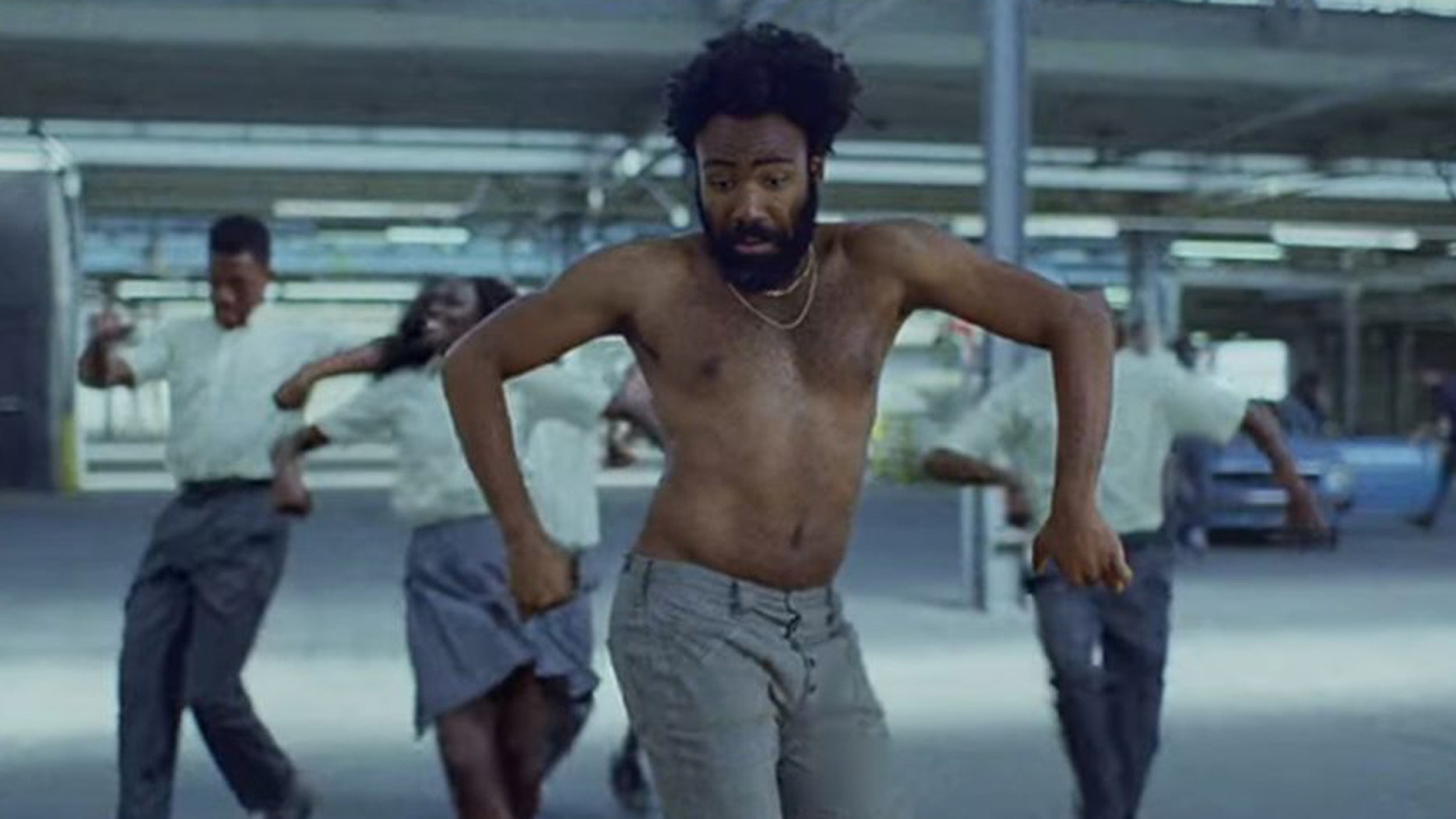 "Donald Glover has taken 2018 by storm as both an actor and musician. Here the rapper dances in the music video for ""This Is America."" (RAC Records)"