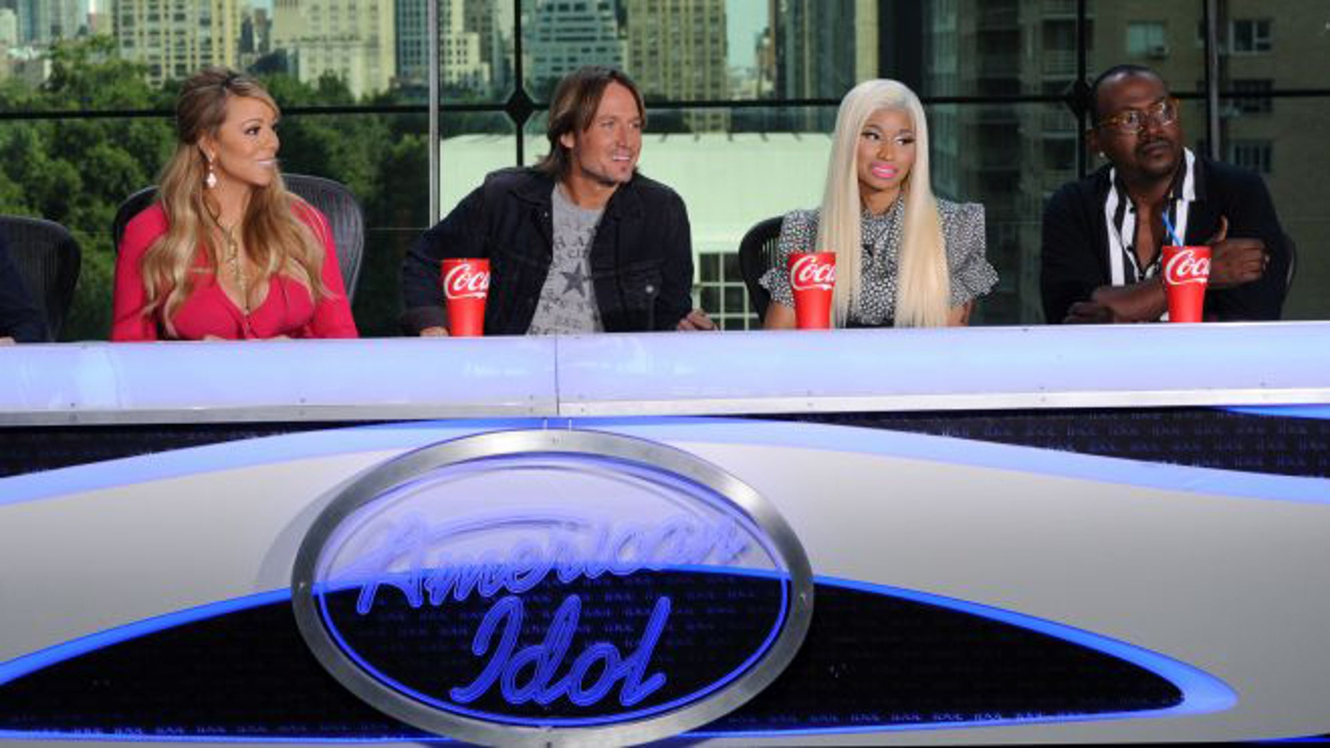 """Sept. 17, 2012: This image released by Fox shows the new judges for the singing competition series """"American Idol."""" From left, Mariah Carey, Keith Urban, Nicki Minaj and Randy Jackson at a news conference in New York City."""