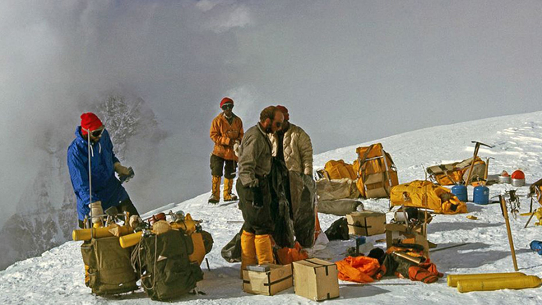 In this 1963 photo released by Henry S. Hall, Jr. American Alpine Club Library, Barry Corbet Personal Papers and Films, members of the 1963 American Mount Everest Expedition team and sherpas are shown with their climbing gear on Mt. Everest.
