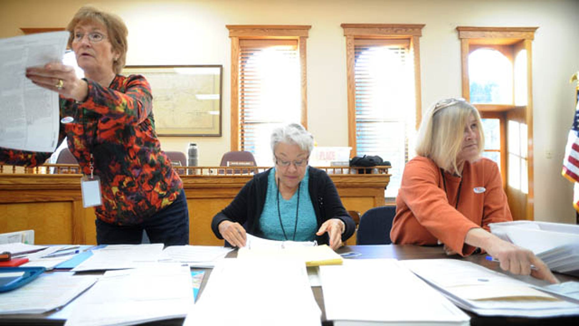 Election officials help voters at the Idaho Springs Courthouse in Idaho Springs, Colo. (AP)