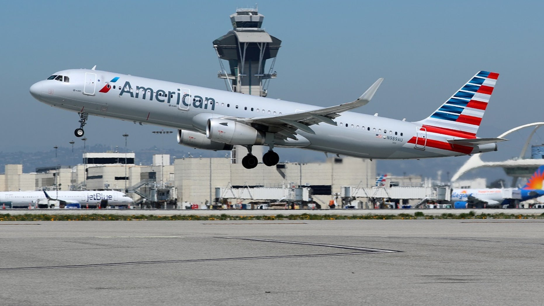 FILE - A New York-Los Angeles American Airlines flight struck an object shortly after departure and was forced to return to New York Wednesday night, officials said.