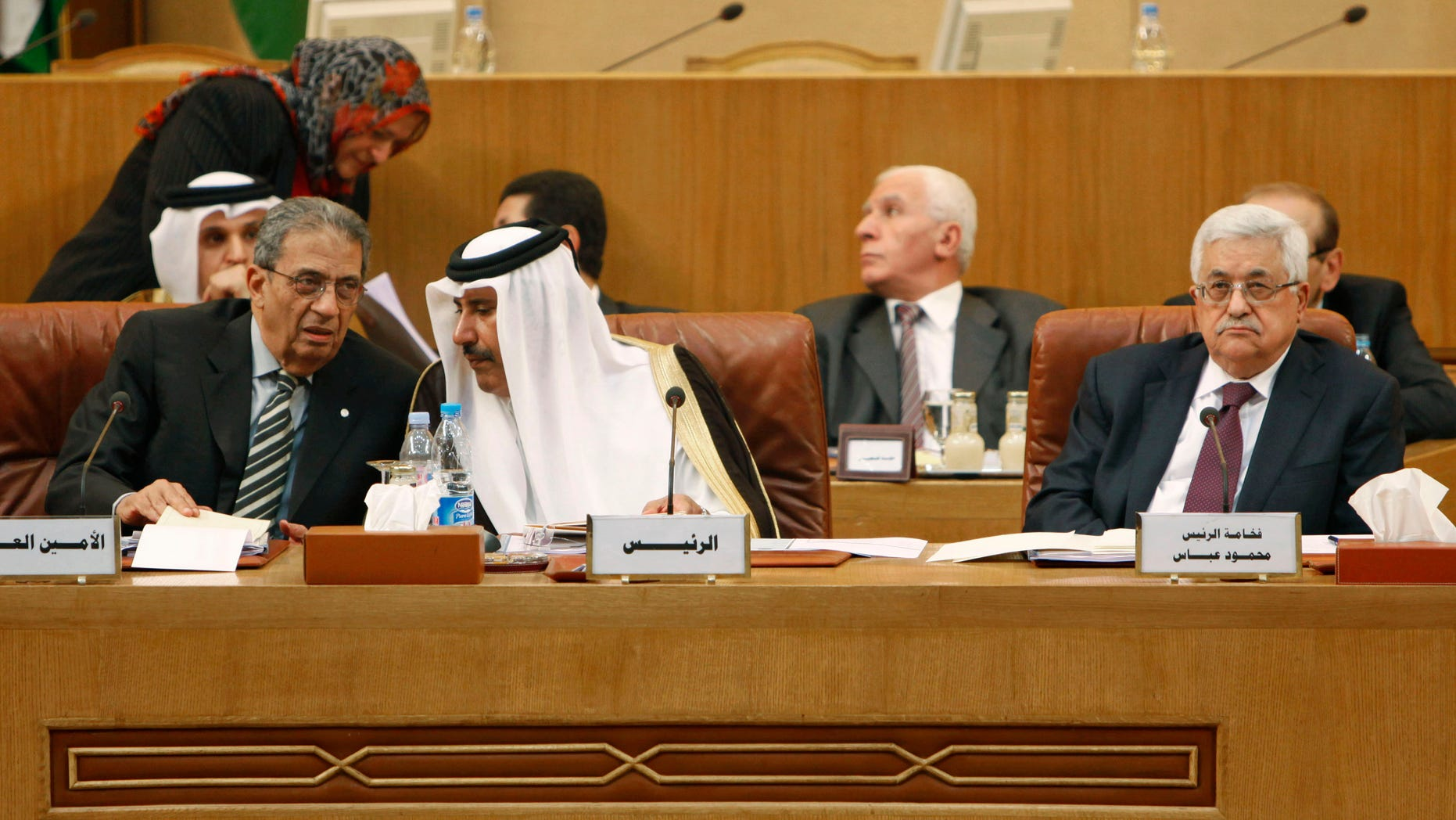 Dec. 15: Front from left, Arab League Secretary General Amr Moussa, Qatari Prime Minister Sheikh Hamad bin Jassem al-Thani and Palestinian Authority President Mahmoud Abbas at the Arab League headquarters in Cairo, Egypt. Amr Moussa says he senses that neither north nor south Sudan have any desire to return to war, ahead of a referendum that could split the country.