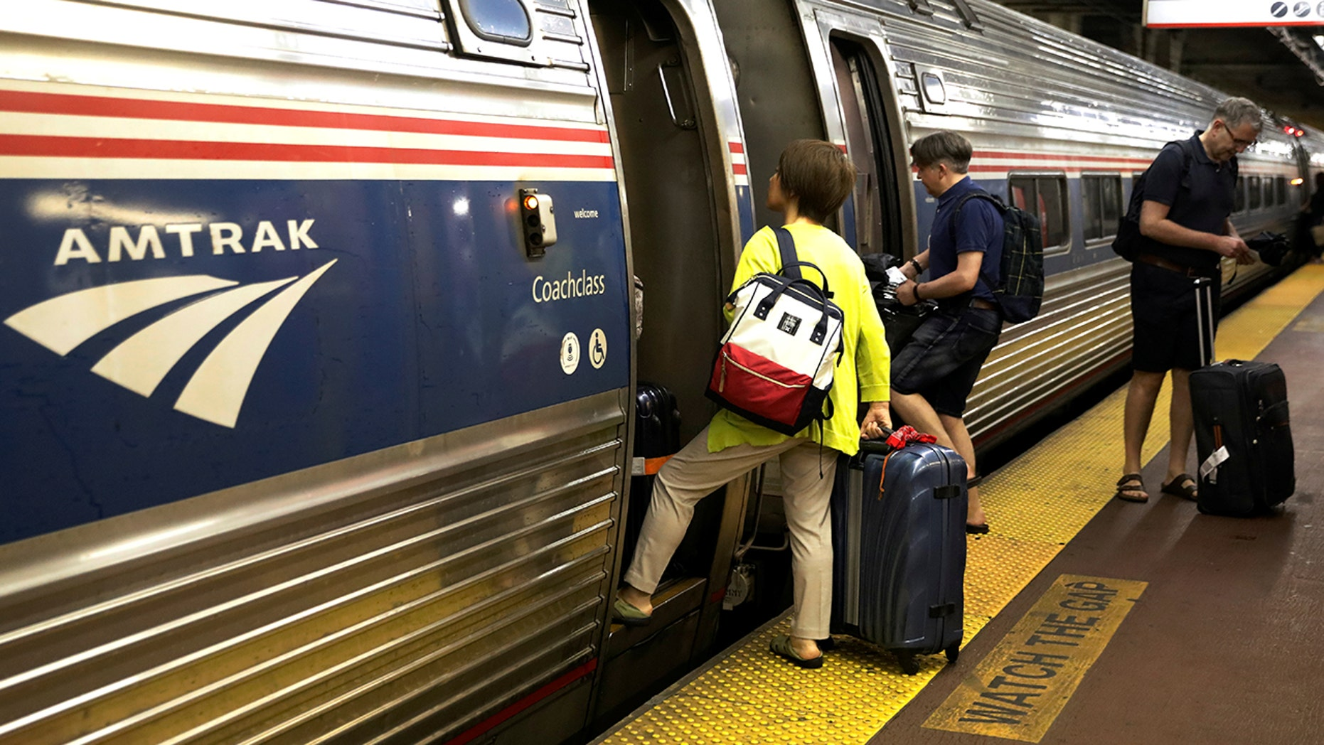Amtrak riders board a train at Penn Station in New York City in an undated photo.