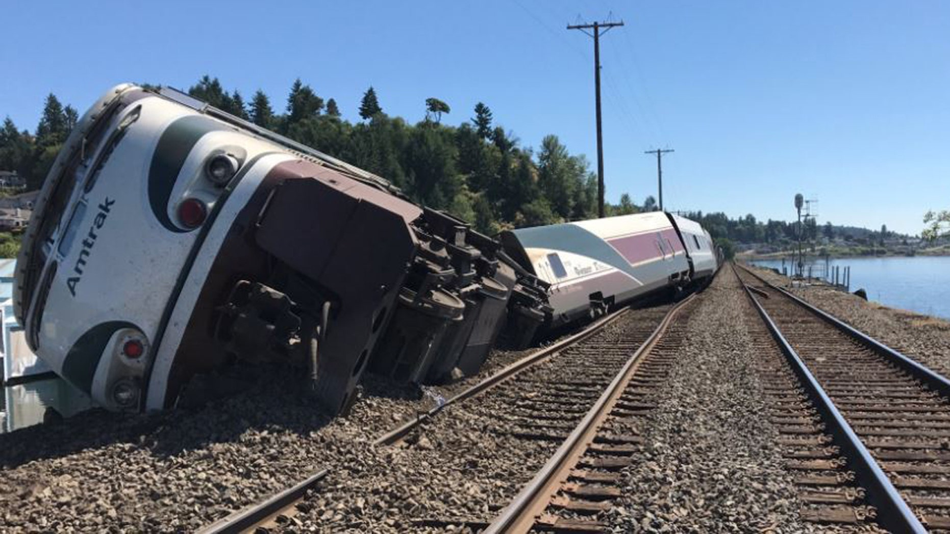 An Amtrak train lies on its side after it derailed in Steilacoom, Wash. Sunday, July 2, 2017.