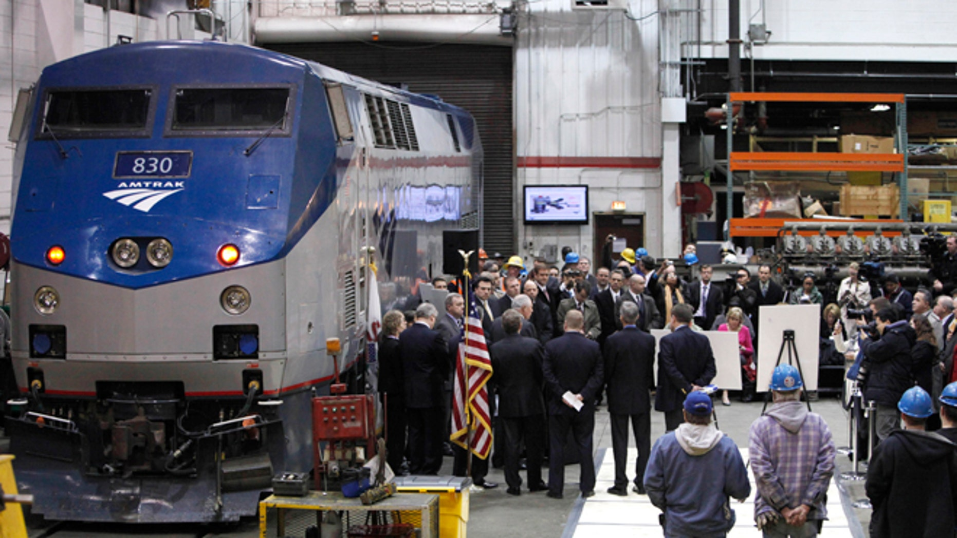 March 22, 2011: In this file photo, Illinois Gov. Pat Quinn and U.S. Sen. Dick Durbin are joined by state and local officials as they announce the next phase of high-speed rail construction during a news conference at an Amtrak maintenance building in Chicago.