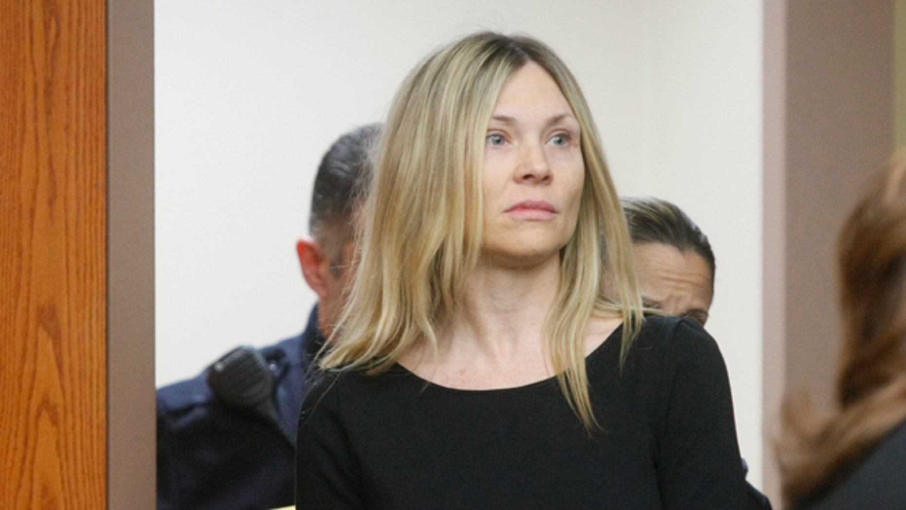 "A judge ruled that ""Melrose Place"" actress Amy Locane Bovenizer will not have to go back to prison."