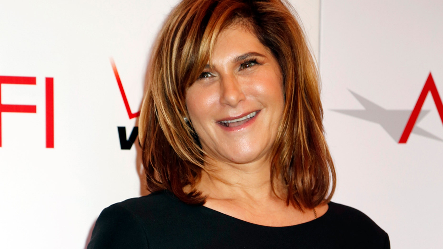 Amy Pascal, chairman of Columbia Pictures, arrives at the AFI Awards 2013 honoring excellence in film and television in Beverly Hills, California January 10, 2014.