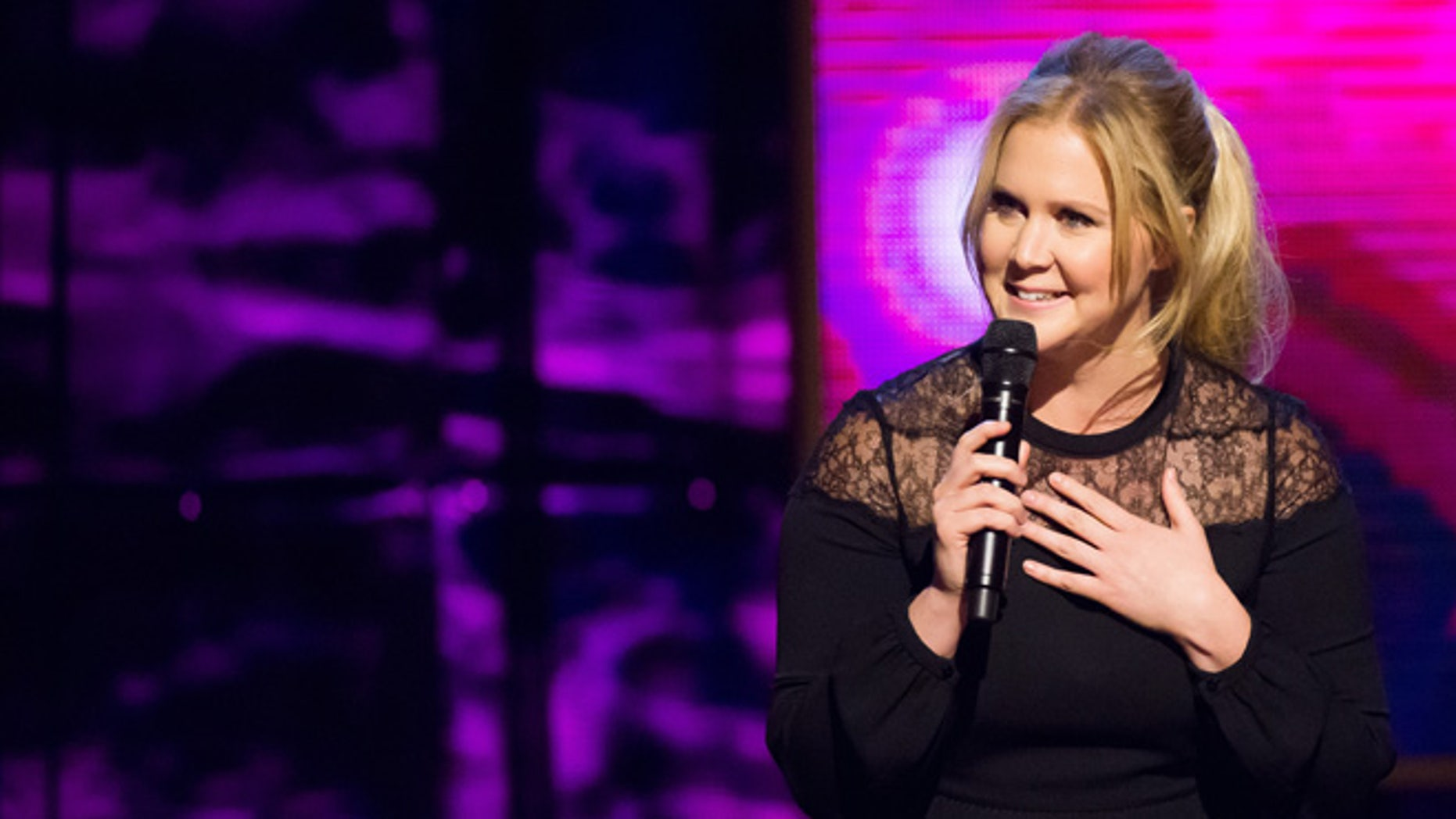 "Feb. 28, 2015. Amy Schumer appears onstage at Comedy Central's ""Night of Too Many Stars: America Comes Together for Autism Programs"" at the Beacon Theatre in New York. Schumer hosts the MTV Movie Awards show on Sunday, April 12, 2015."