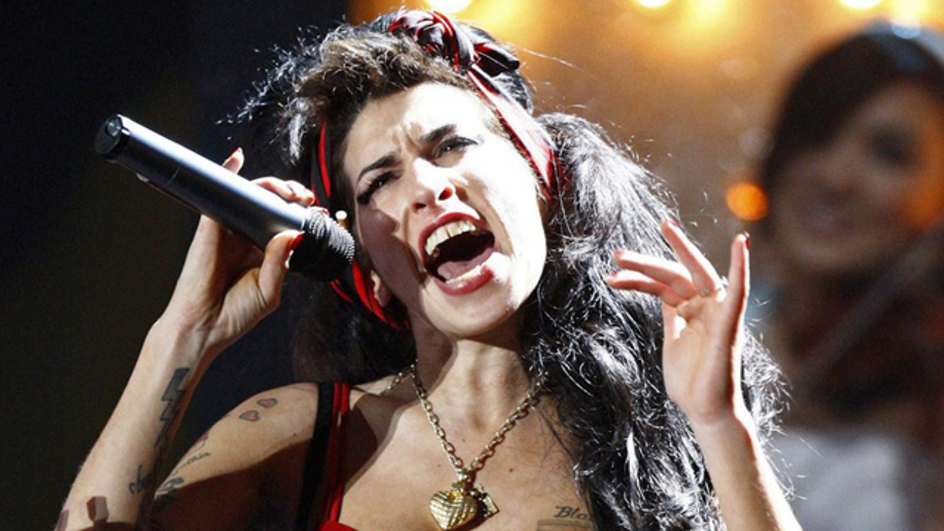 FILE PHOTO: British singer Amy Winehouse performs at the Brit Awards at Earls Court in London.