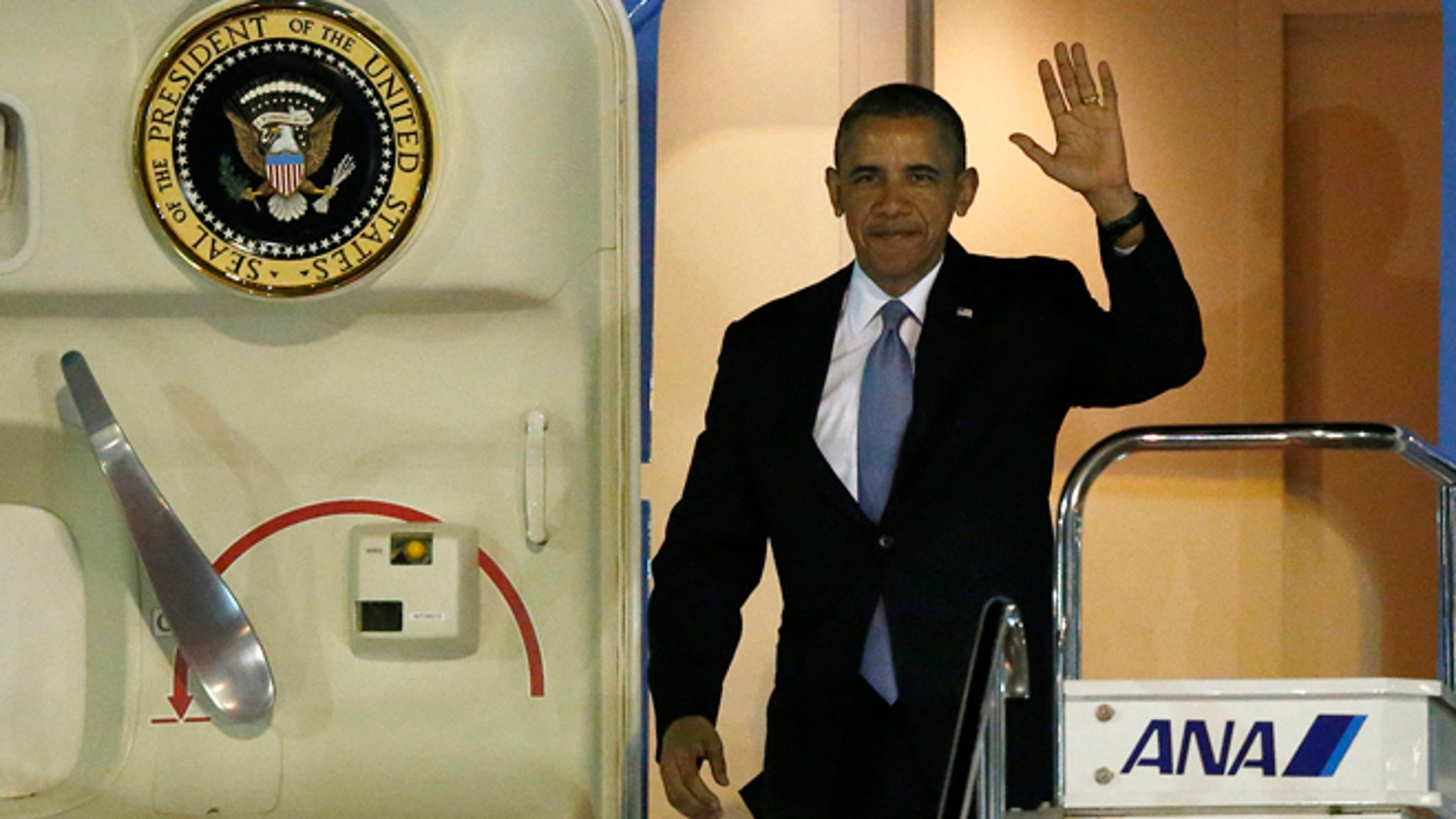 April 23: President Obama steps out from Air Force One as he arrives at Haneda International Airport in Tokyo.