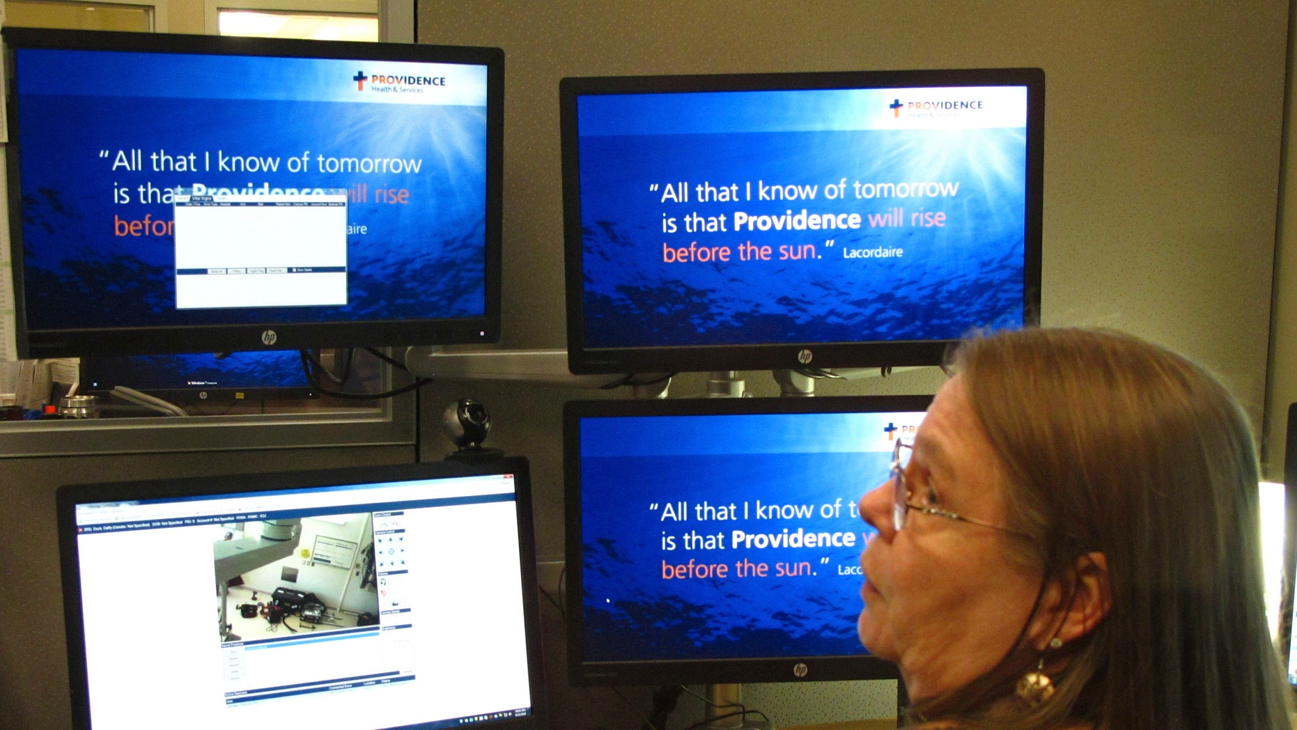 In this photo taken Sept. 13, 2016, intensive care unit nurse Deborah Springer in Anchorage, Alaska, demonstrates the focusing ability of a telemedicine camera that is part of a new telemedicine partnership between the Iliuliuk Family and Health Services on Unalaska Island and Providence Alaska Medical Center. Beginning Thursday, Sept. 22, the Anchorage hospital will virtually beam critical care doctors 800 miles away to the emergency room of the clinic to assist staffers there during medical emergencies, thanks to a satellite link instead of the usual fiber optics.