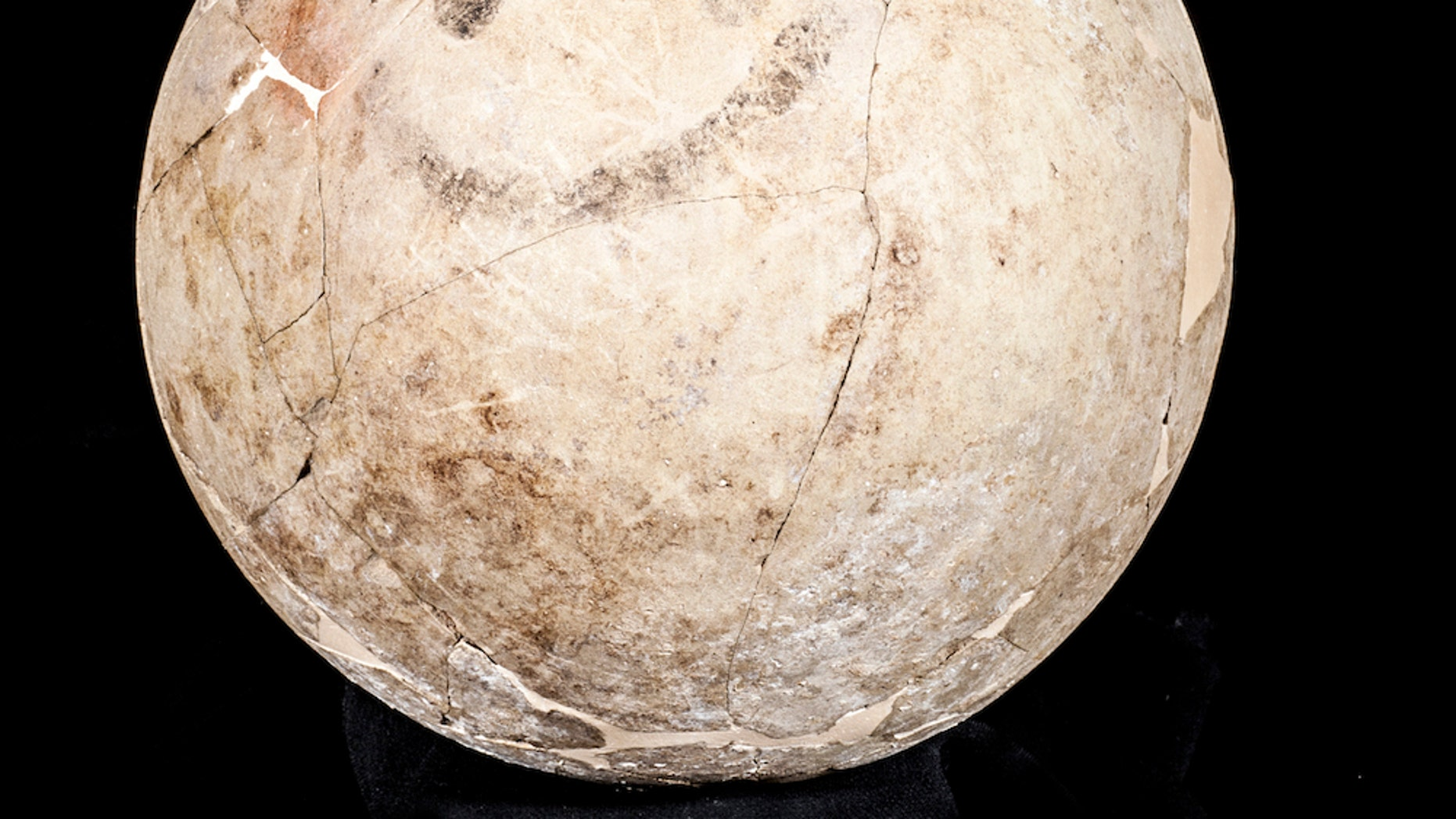 """Perhaps the world's oldest """"smile"""" — a painted flask from 1700 B.C. found in a burial site in Karkemish, an ancient city in modern-day Turkey."""