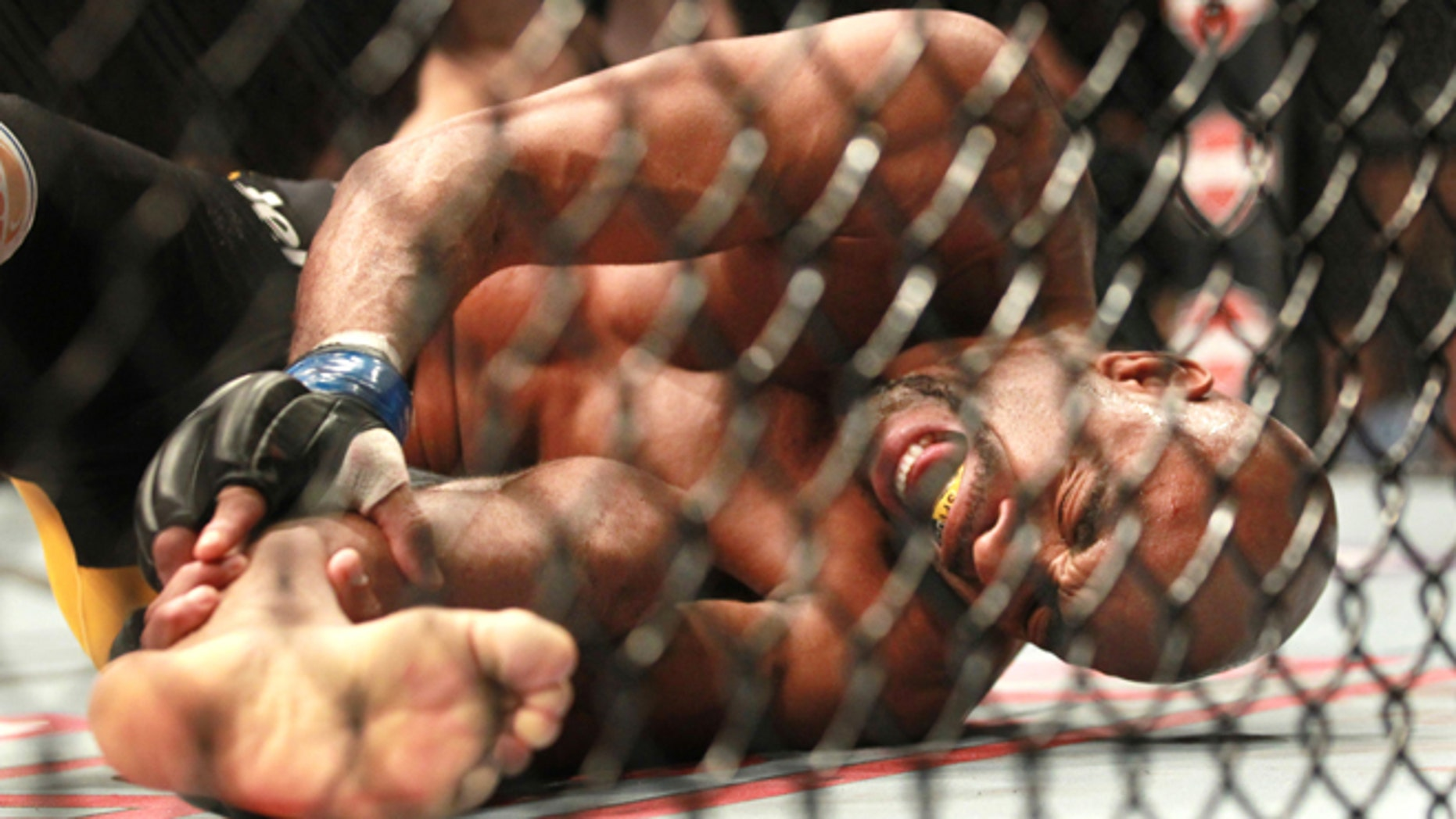 Dec. 28, 2013: Anderson Silva screams after kicking Chris Weidman and injuring his leg during the UFC 168 mixed martial arts middleweight championship bout.